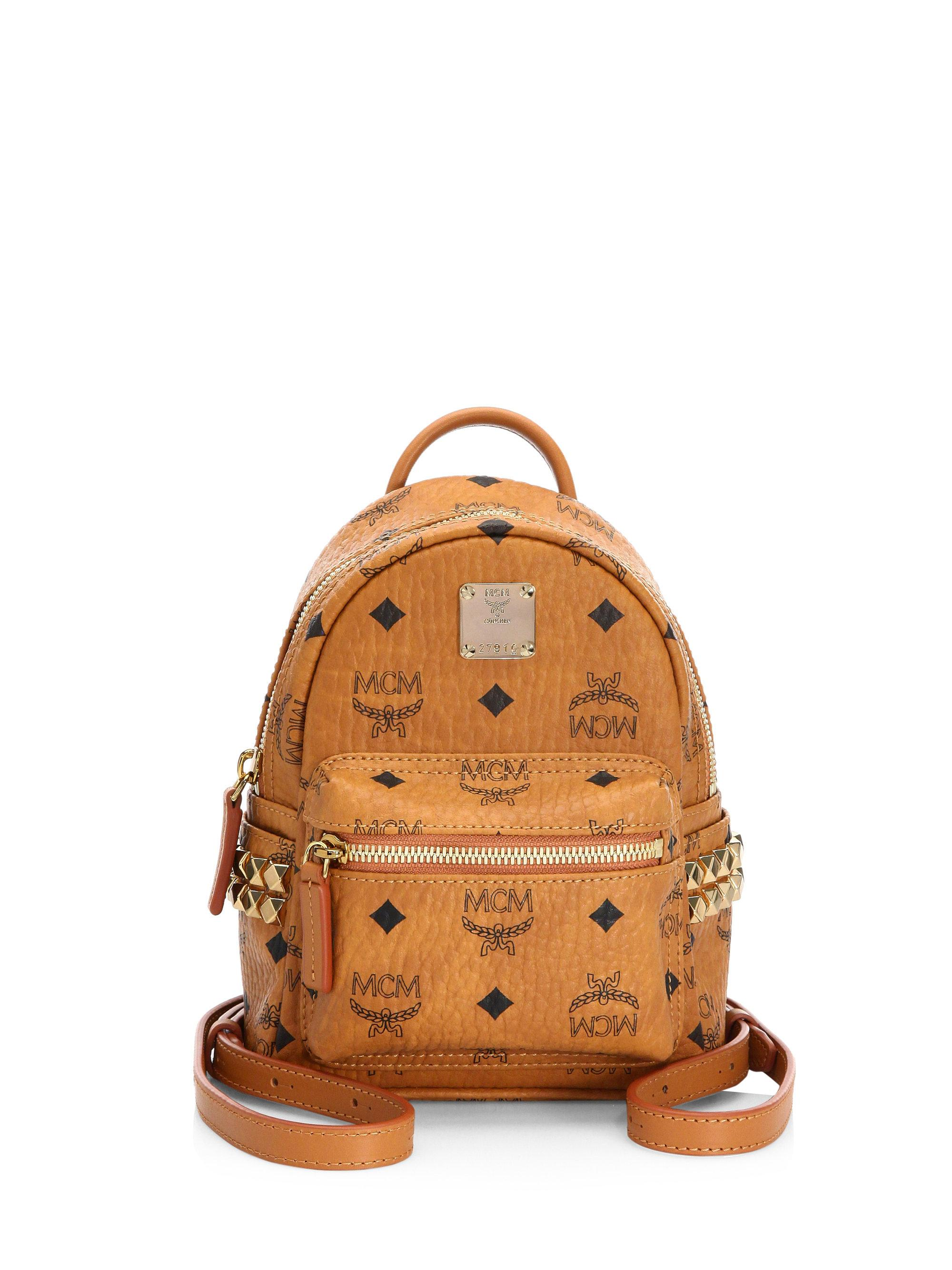 802aab2782e Lyst - MCM Bebe Boo X Mini Studded Coated Canvas Backpack in Brown