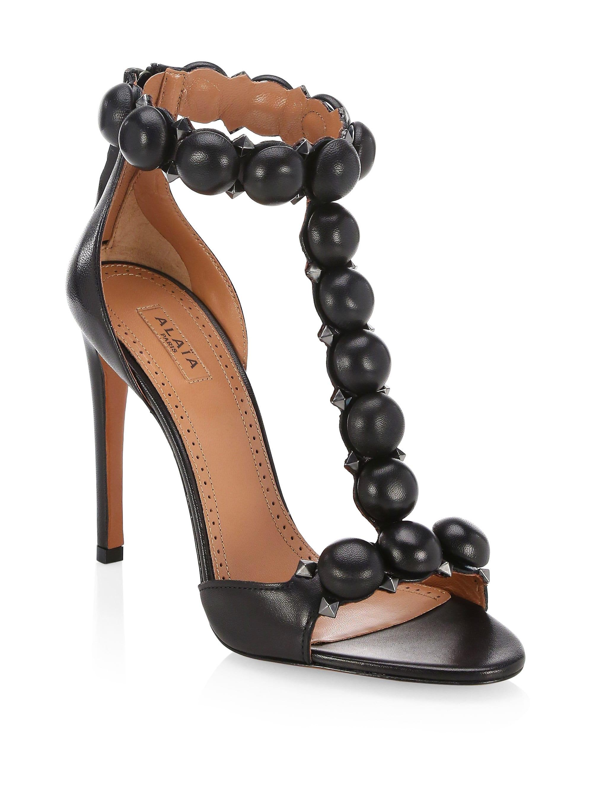 6380eda9d878 Alaïa Bombe T-strap Leather Sandals in Black - Save 5% - Lyst