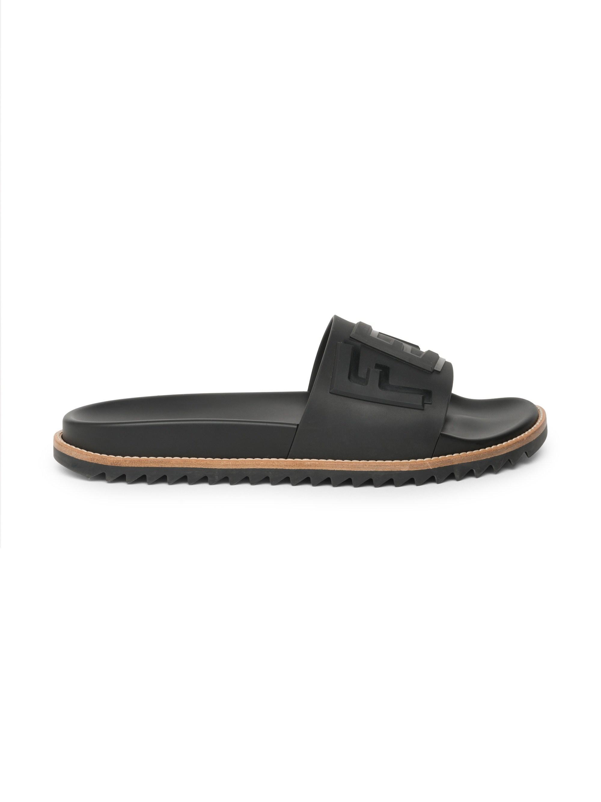 91c068a4 Lyst - Fendi Logo Embossed Slide Sandals in Black