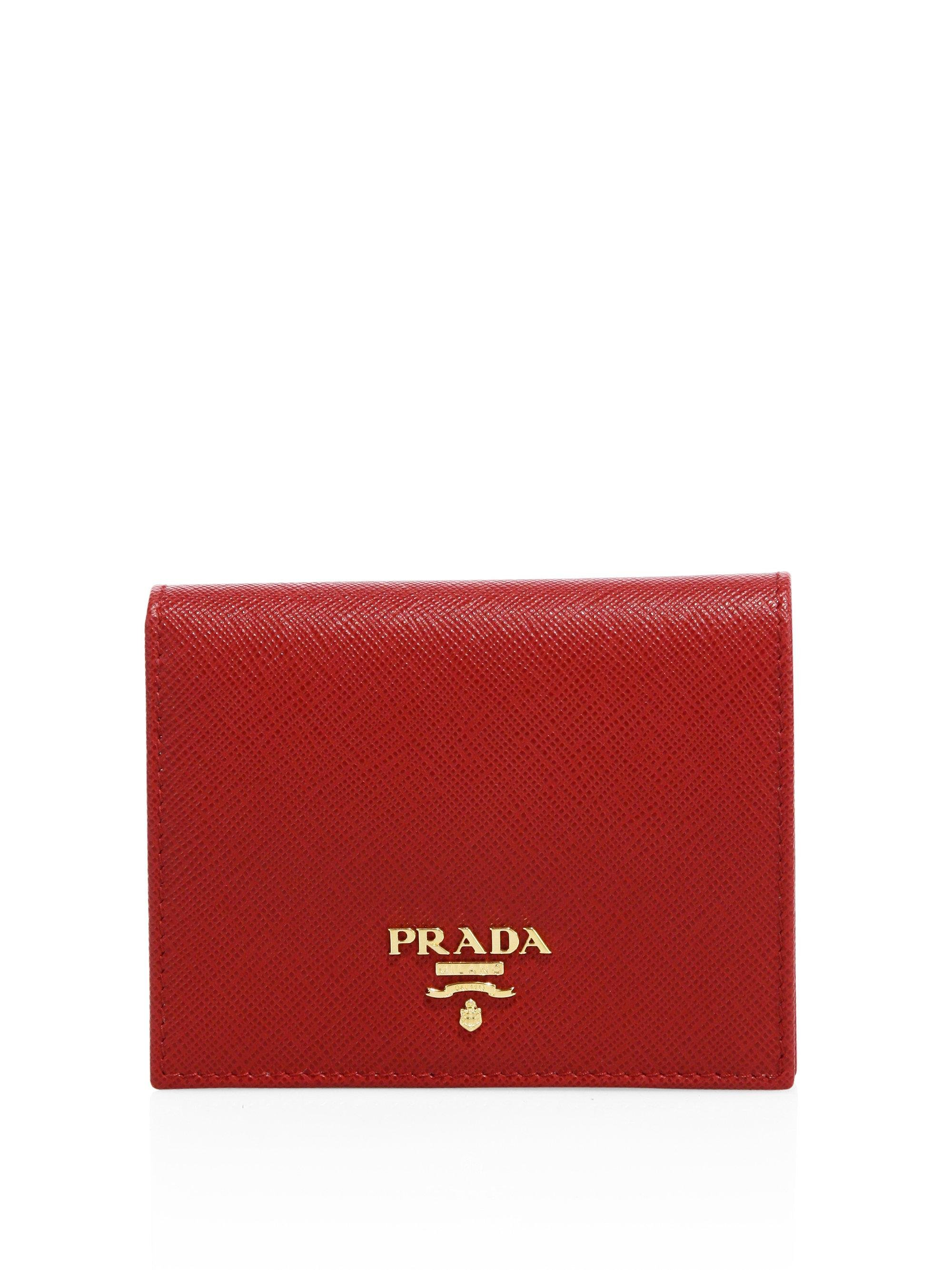 29bf16081f5f ... where to buy prada red mini saffiano leather bifold wallet lyst. view  fullscreen 37e4d b5104