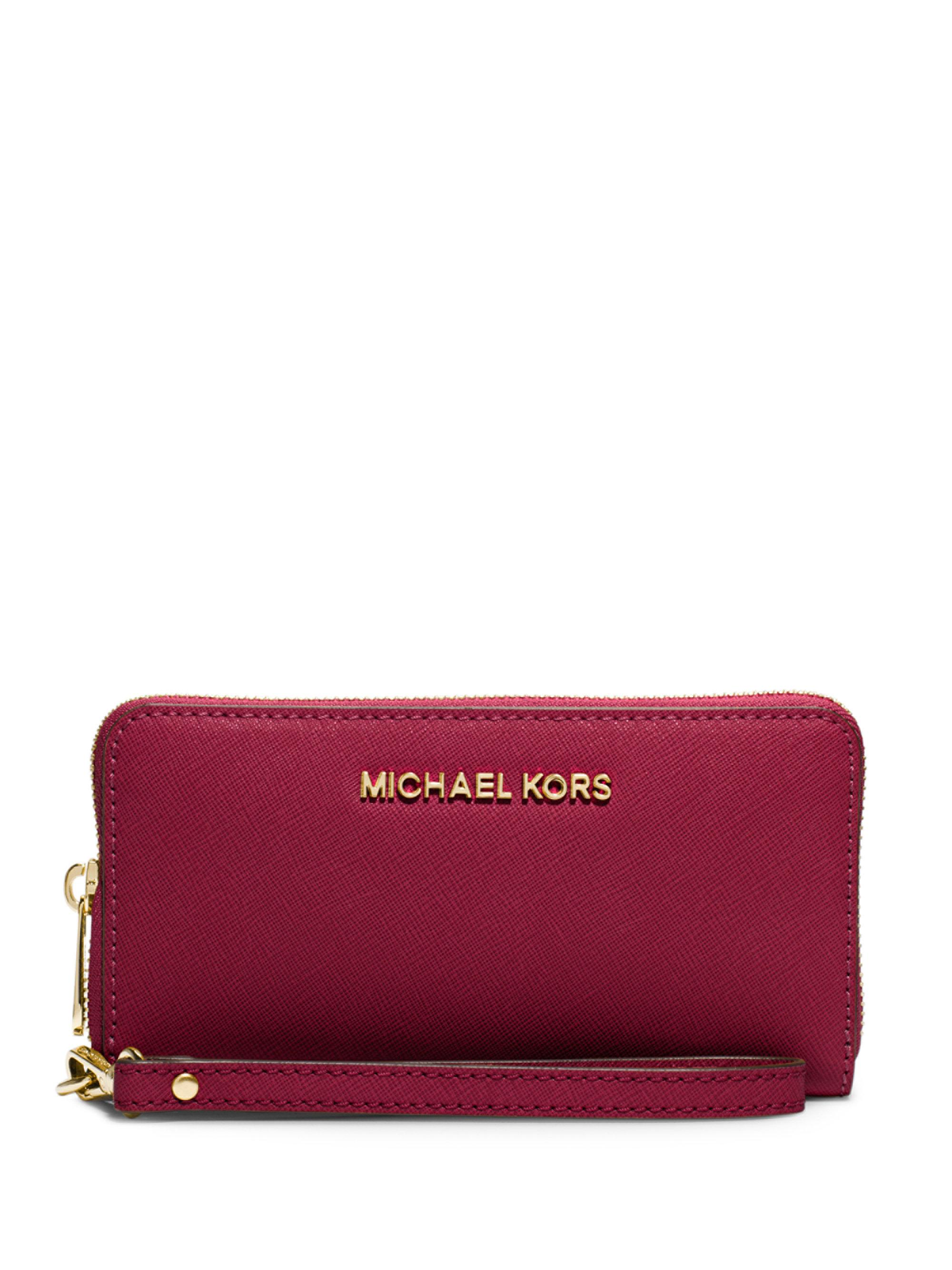 169f8fc9bcaf Lyst - Michael Kors Large Smartphone Wristlet in Red