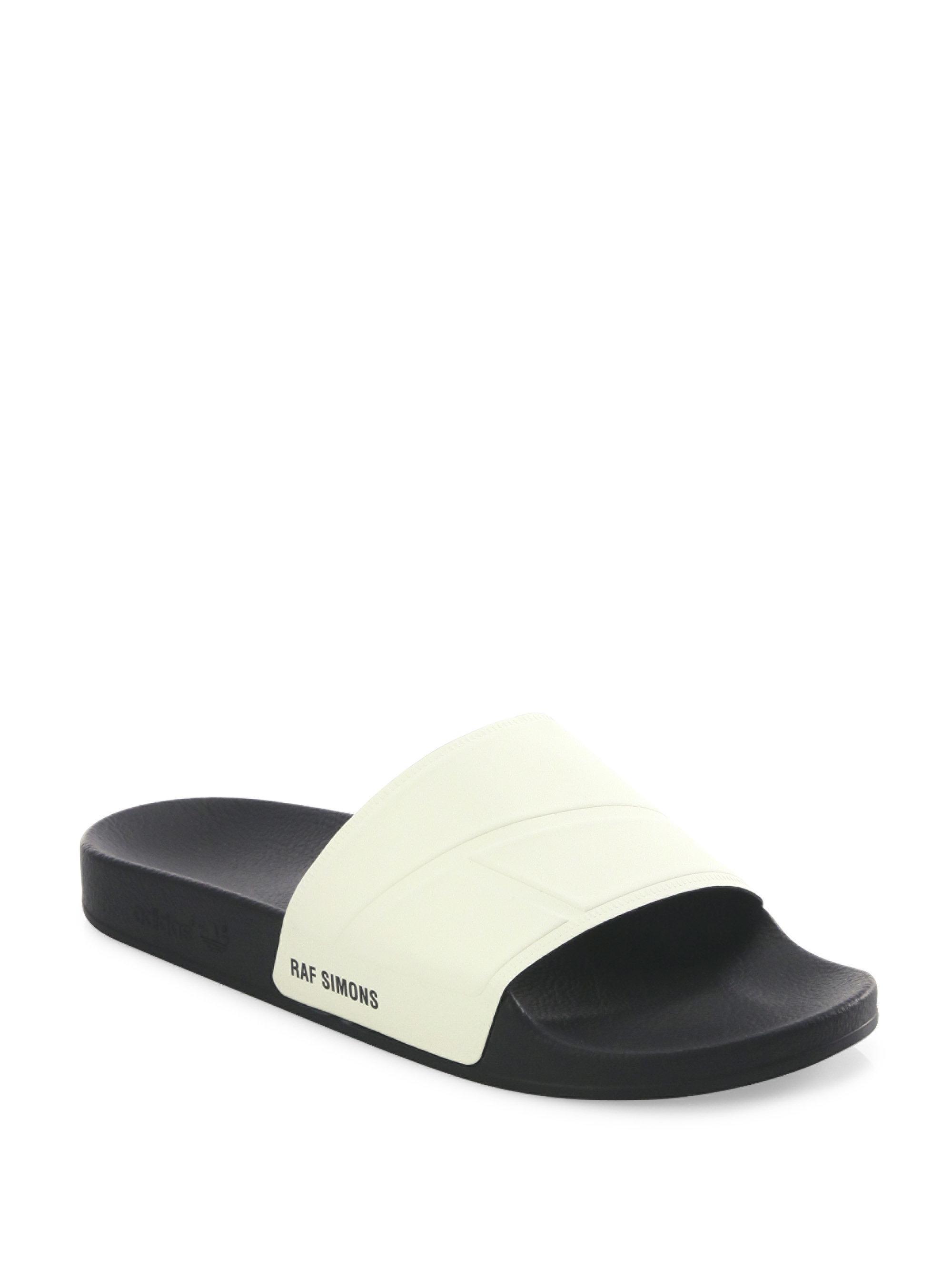 6c9e77bde377 adidas By Raf Simons Bunny Adilette Rubber Slides in Black for Men ...