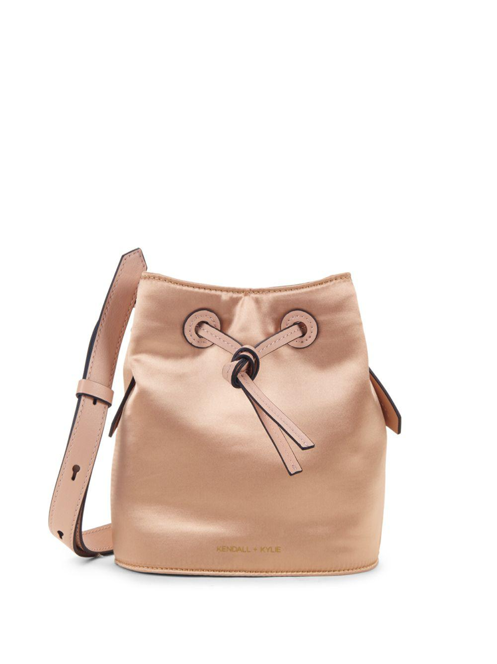 12a3218c3c Lyst - Kendall + Kylie Micro Satin Drawstring Bucket Bag in Natural