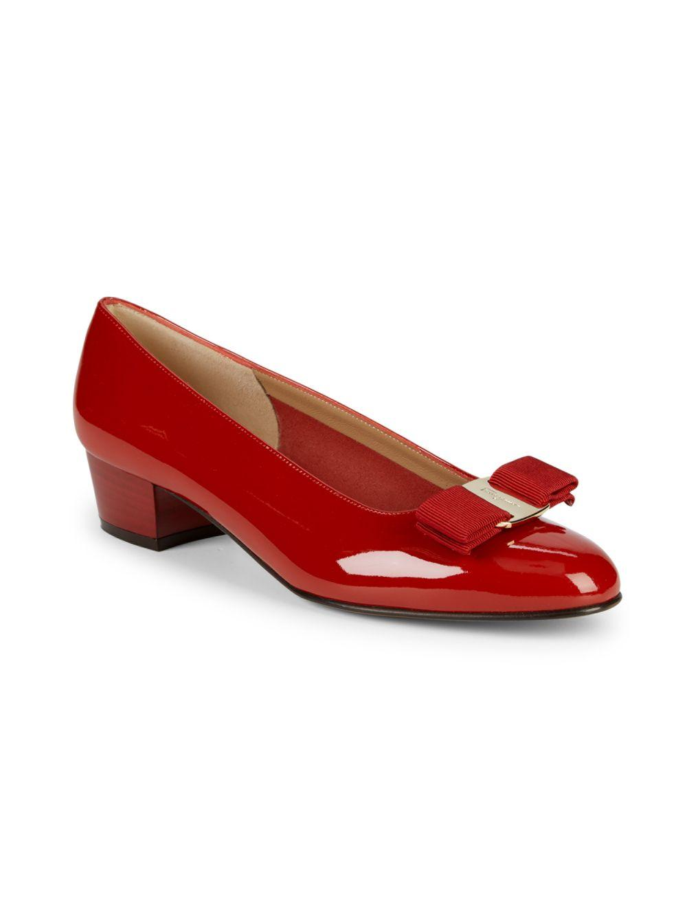 939ab6d94ff2 Lyst - Ferragamo Bow Detail Patent Leather Pumps in Red