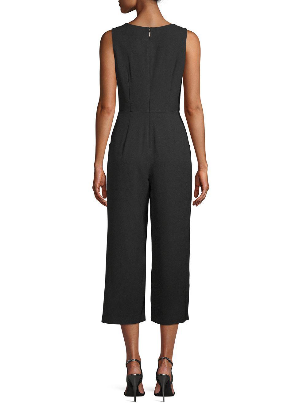 57cef658cd ... Black V-neck Sleeveless Jumpsuit - Lyst. View fullscreen