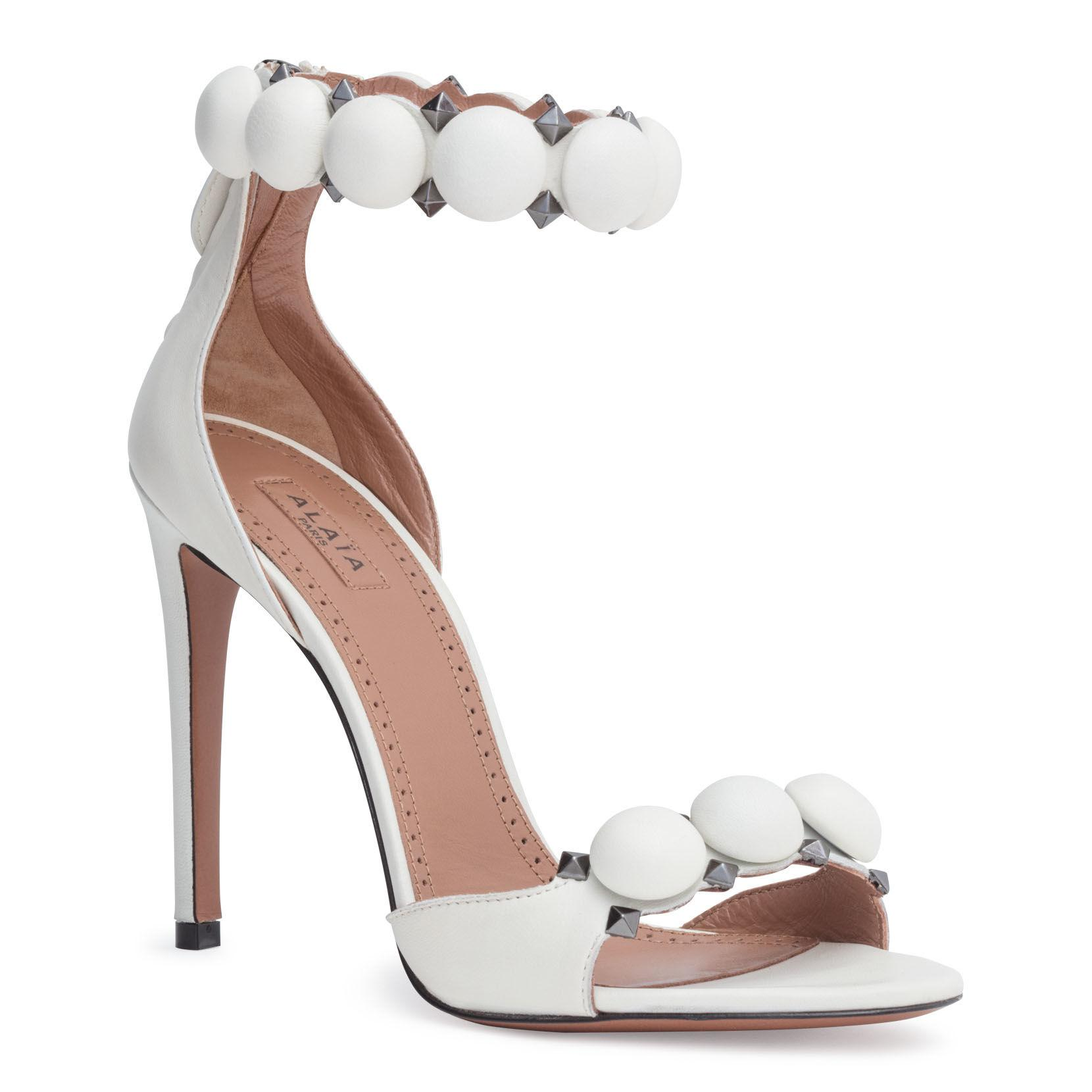 02f476975251 Lyst - Alaïa White Leather Bomb Sandals in White