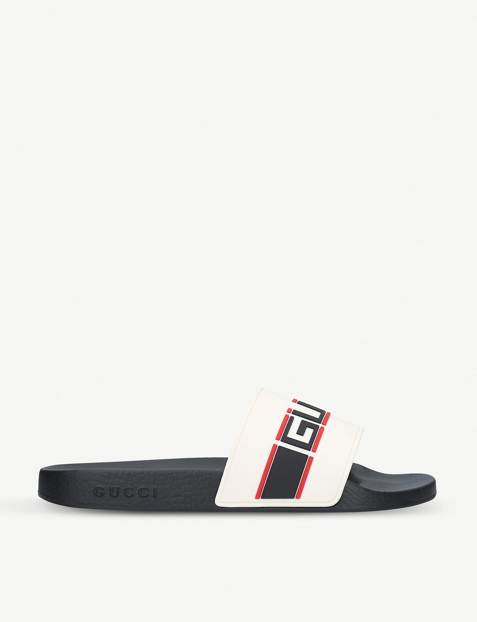 new products f0eec b50c7 Gucci Logo-embossed Rubber Sliders for Men - Lyst