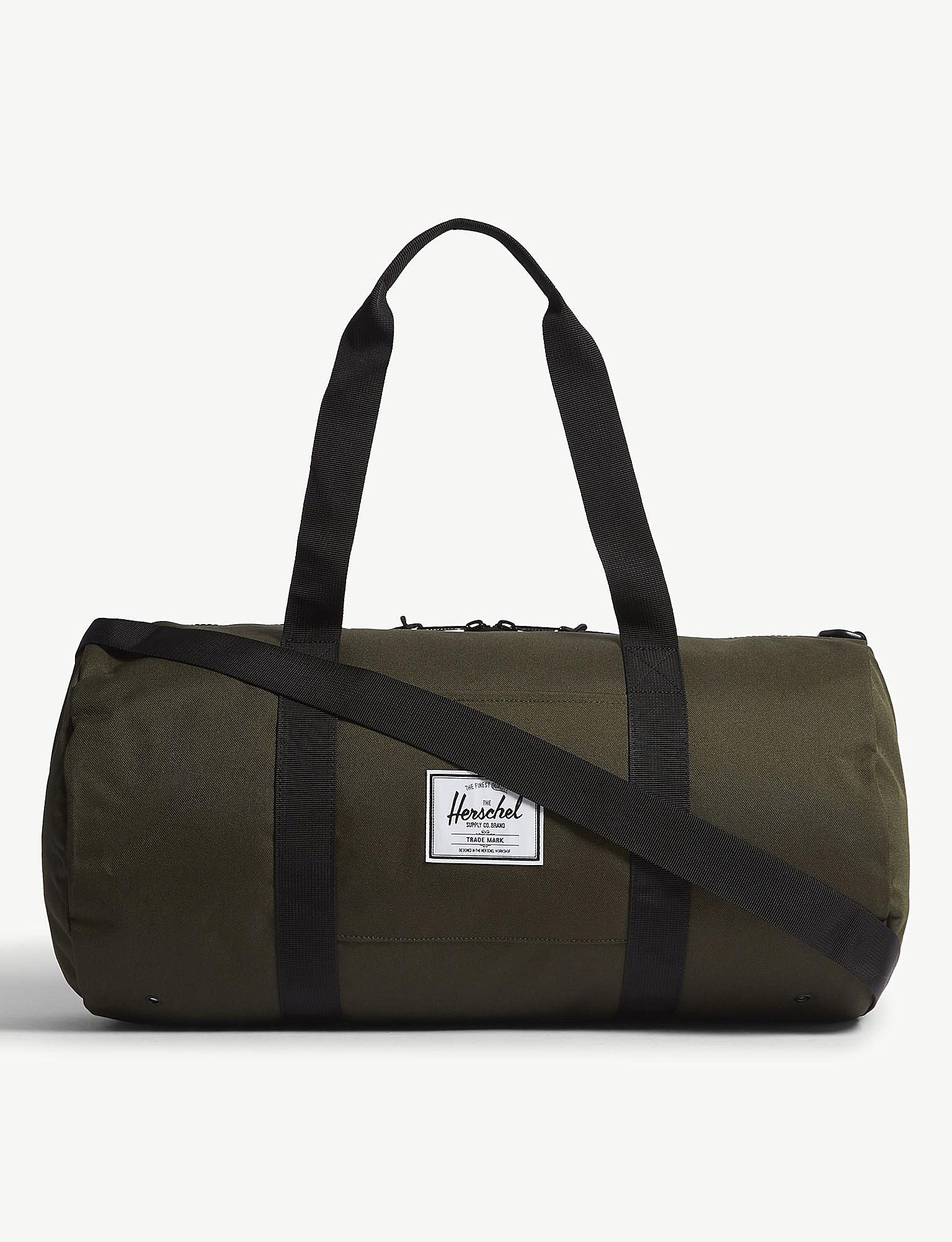 31f0d89e7635 Lyst - Herschel Supply Co. . Green Co. Sutton Duffel Bag in Black ...