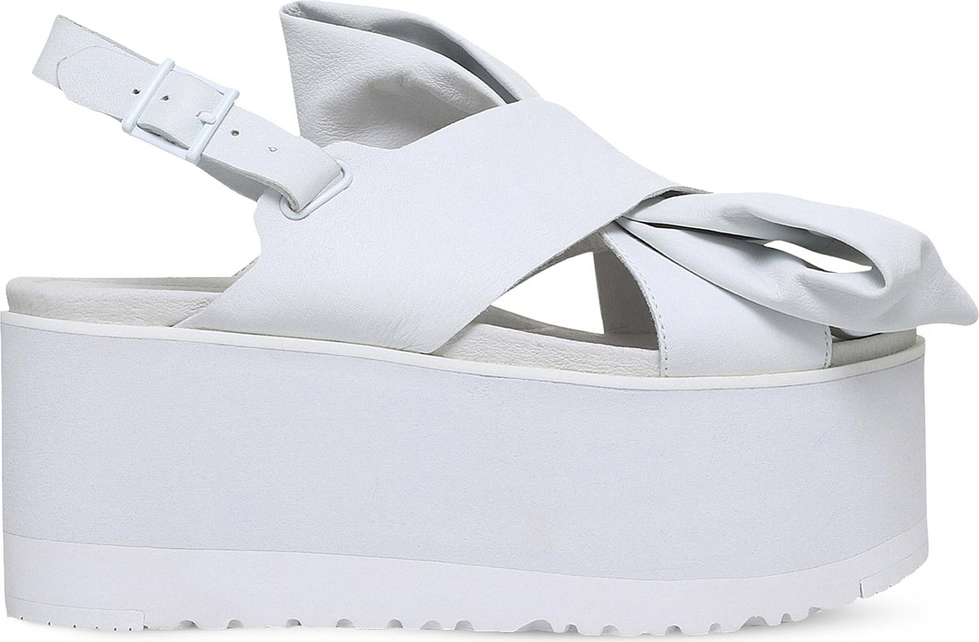 33707b3aaf8 UGG X Preen Moon Bow Leather Sandals in White - Lyst