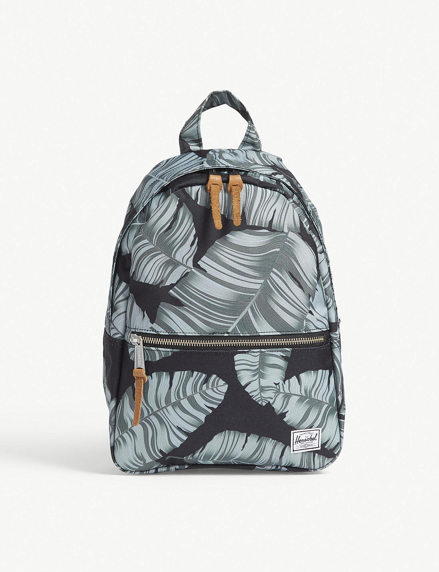 Herschel Supply Co. . Black Palm Floral Town Xs Backpack in Black ... 018351f159