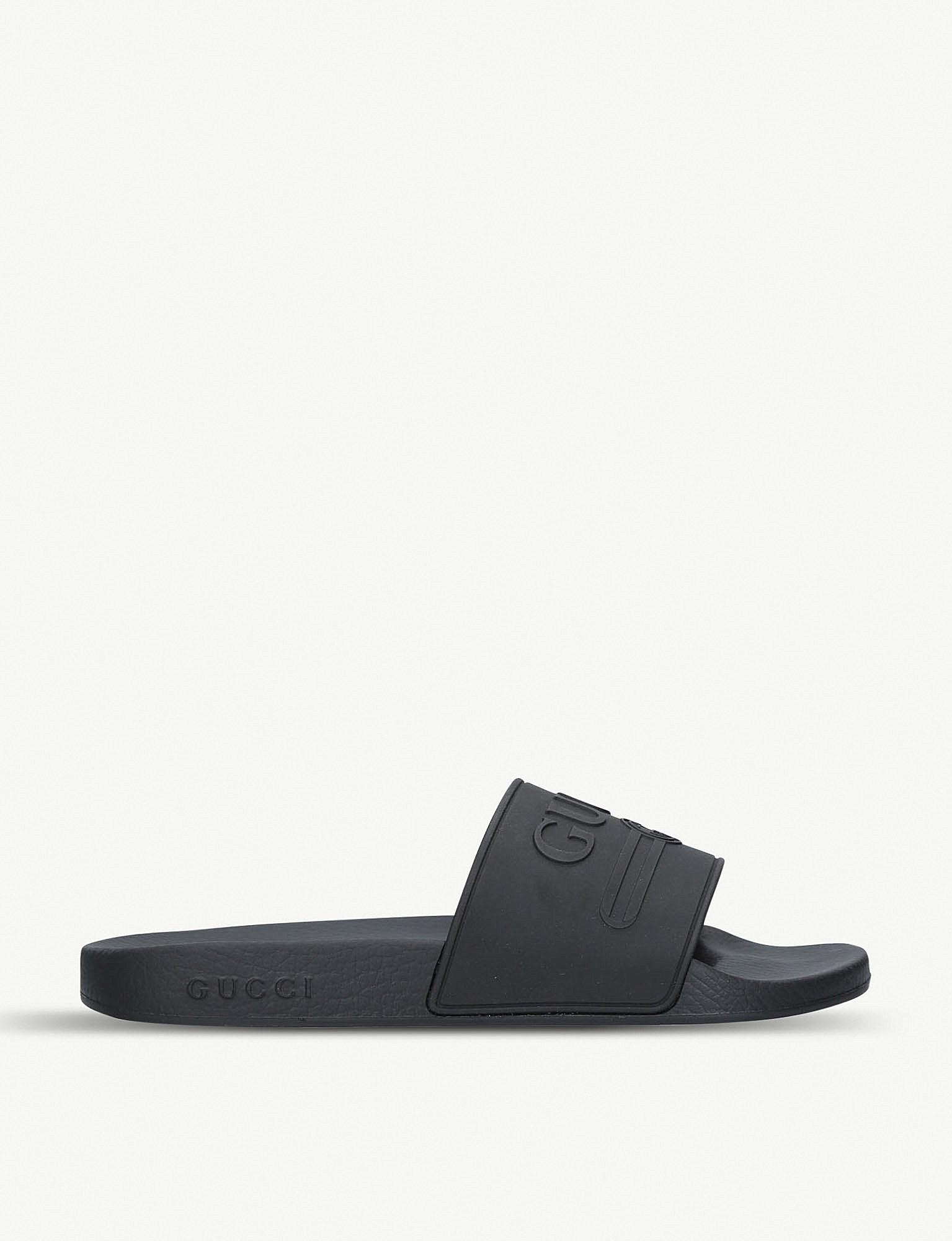 7a2993c8765 Lyst - Gucci Logo Rubber Slide Sandals in Black for Men - Save 4%