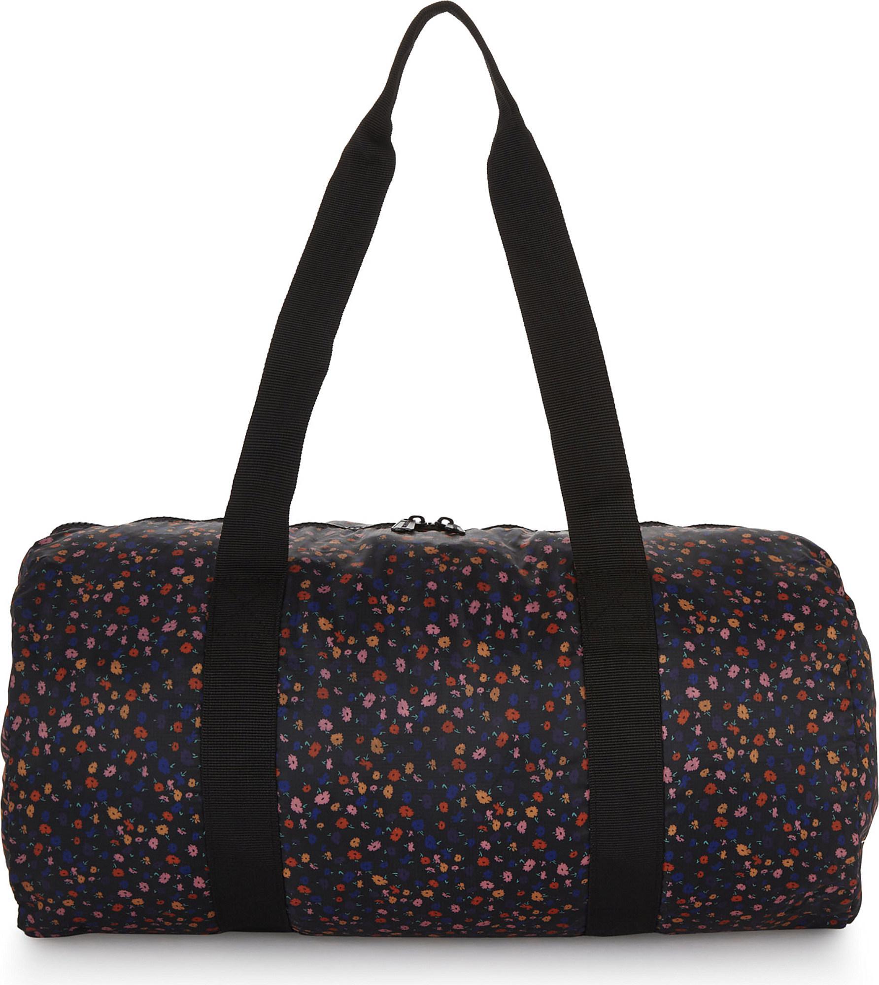 Lyst - Herschel Supply Co. Packable Floral-print Duffel Bag In Black - Save 5%
