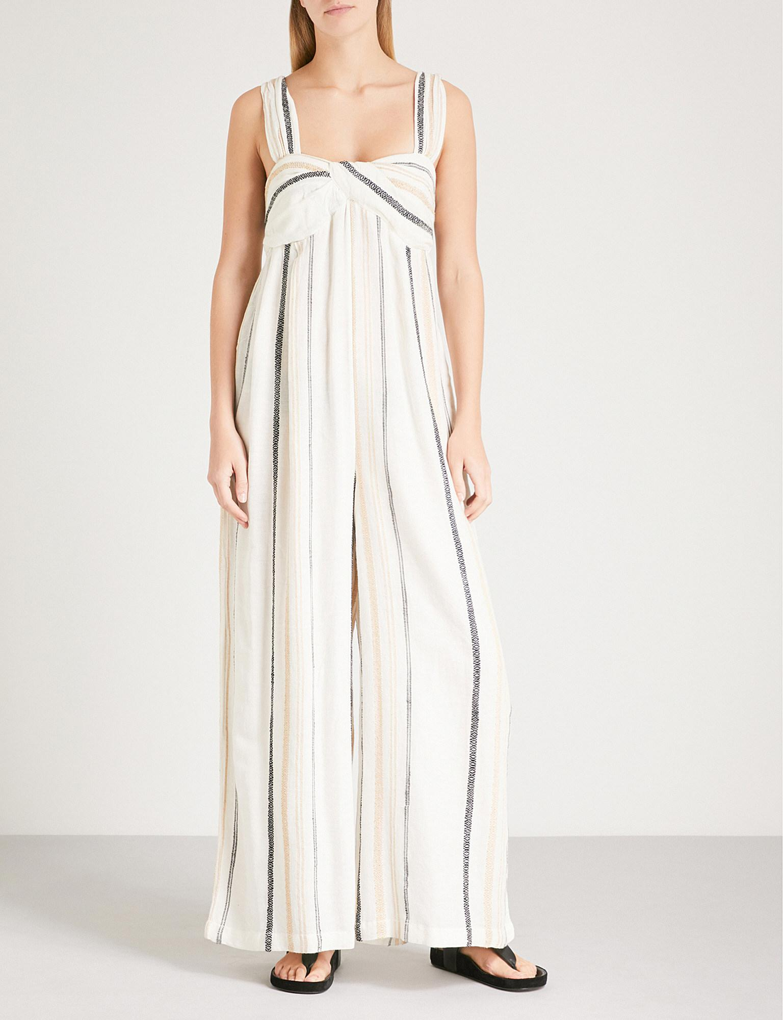 094691fc59aa Lyst - Free People Breezin Through Woven Jumpsuit in Natural