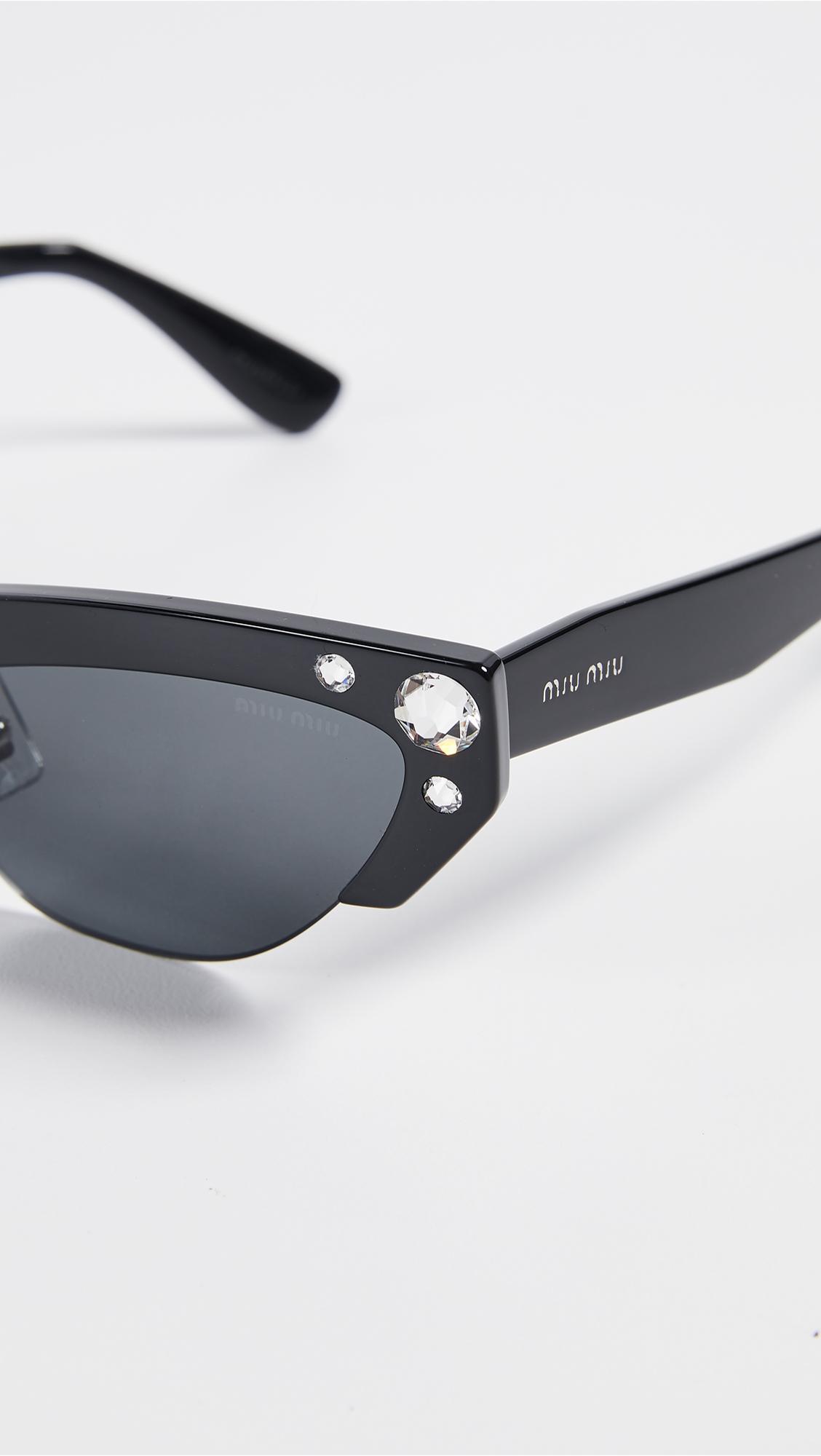 5a45b516e2 Miu Miu Narrow Cat Eye Sunglasses - Lyst
