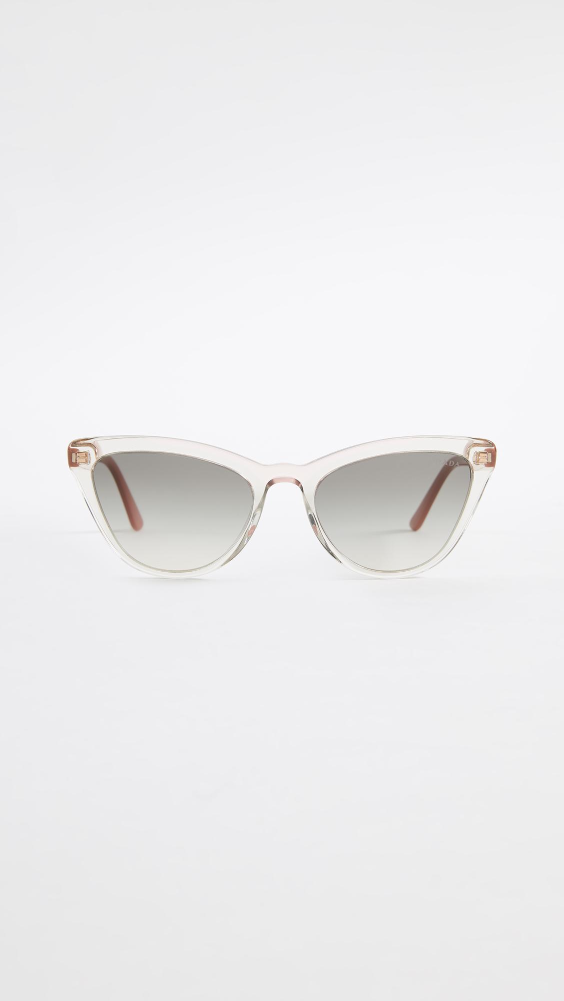 2b7316f4e6 Prada. Women s Pr 01vs Ultravox Cat Eye Sunglasses