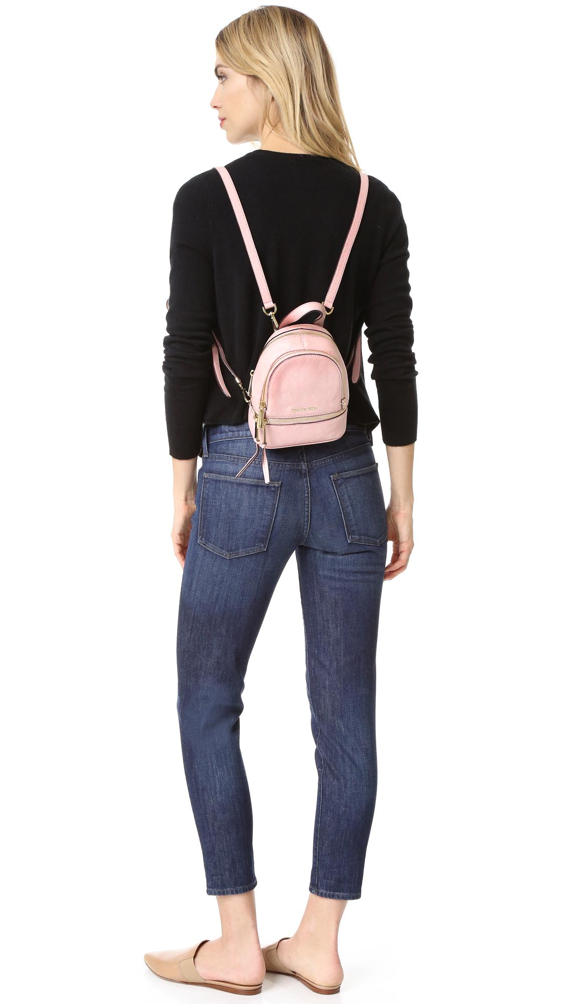 ... new zealand lyst michael michael kors rhea mini backpack in pink d40b5  b2f6a f2d111b07fac7