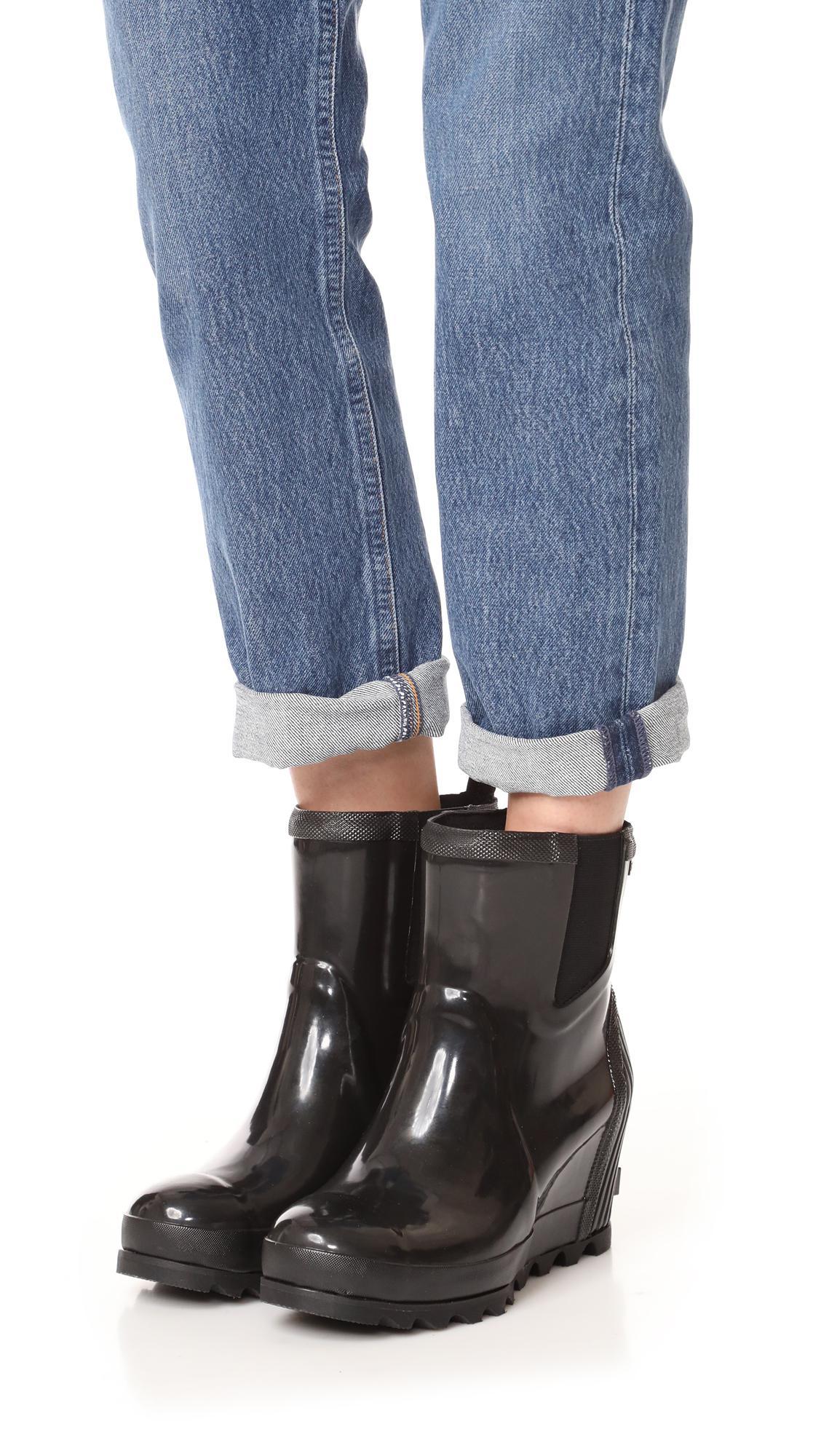 e366444bd735 Lyst - Sorel Joan Rain Wedge Chelsea Gloss Rain Booties in Black