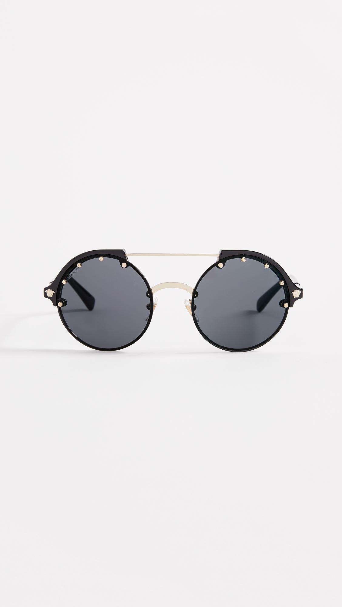 2234ac32e4 Versace. Women s Ve4337 Round Aviator Sunglasses