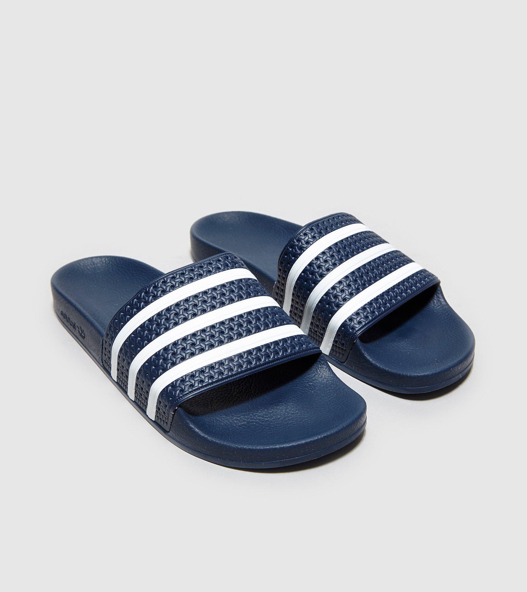 adea1c323509b7 Adidas Originals Adilette Slides in Blue for Men - Lyst