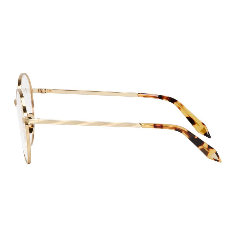 ea730d4808d Victoria Beckham - Metallic Gold Panto Glasses - Lyst. View fullscreen