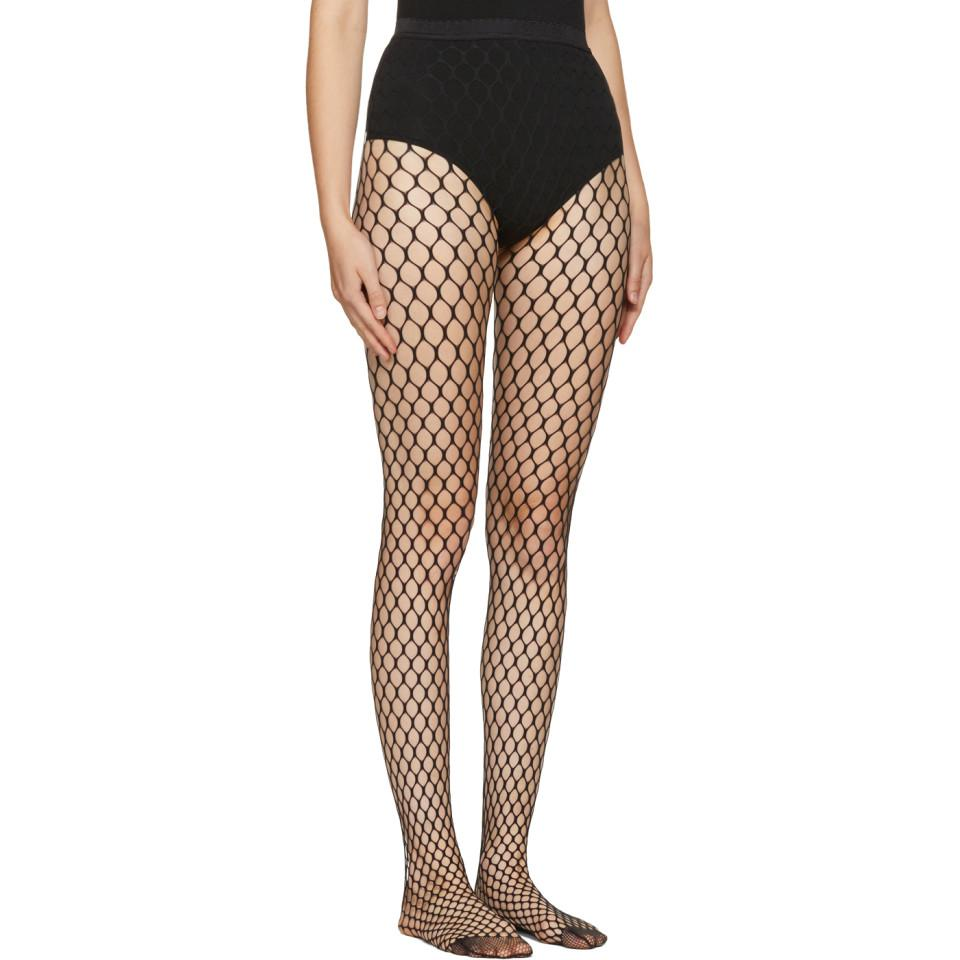 cc4e85268cfeb Lyst - Wolford Black Madeline Fishnet Tights in Black