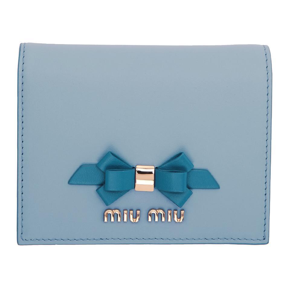 68a3ff5d64ea Lyst - Miu Miu Blue Bow Bifold Wallet in Blue