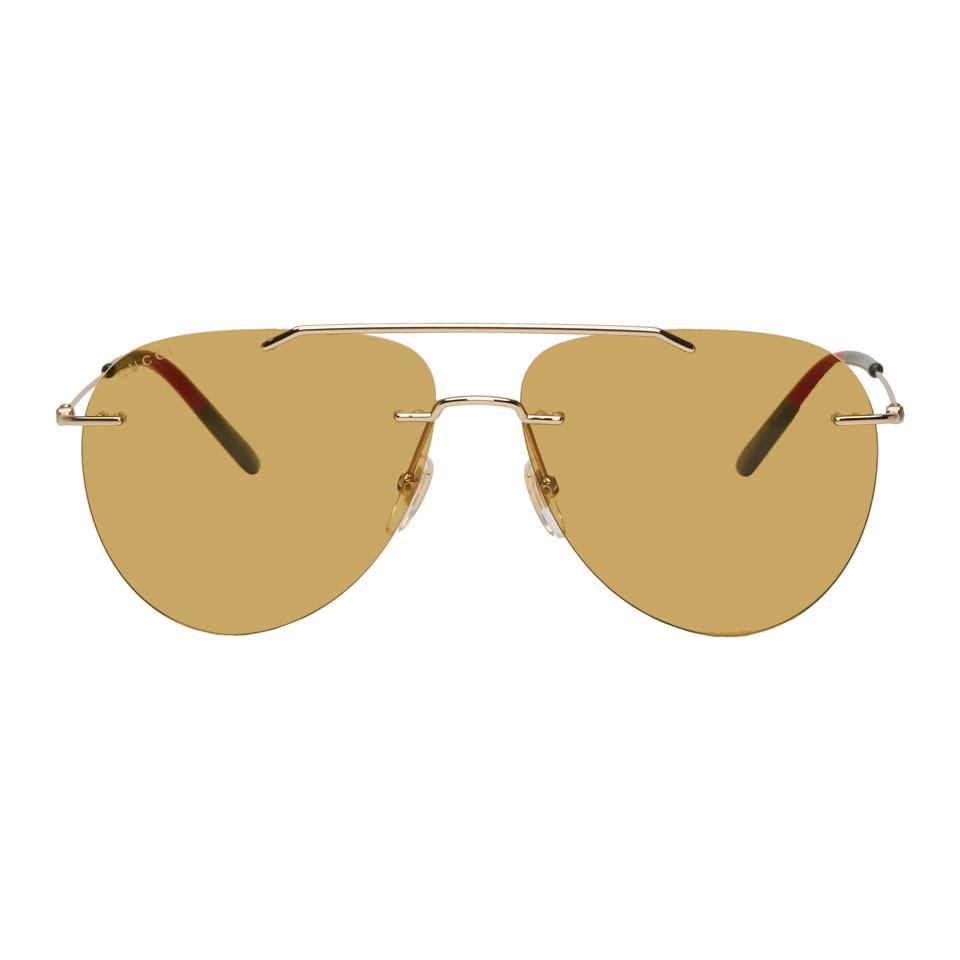 7a65fae5680 Lyst - Gucci Gold Rimless Pilot Sunglasses for Men