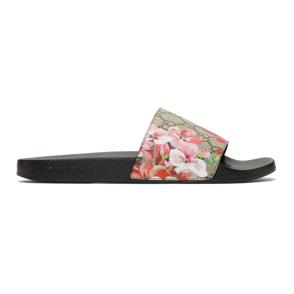 fefe6fdde13a7 Gucci. Women s Blooms Supreme Canvas Slides