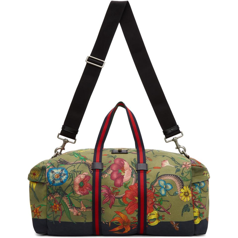 93f4360e54c Lyst - Gucci Green Canvas Flora Snake Duffle Bag in Green