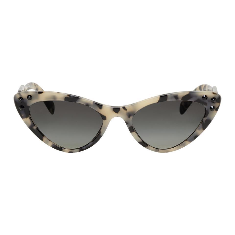 6f81637fb92 Lyst - Miu Miu Beige Logomania Cat-eye Sunglasses in Natural