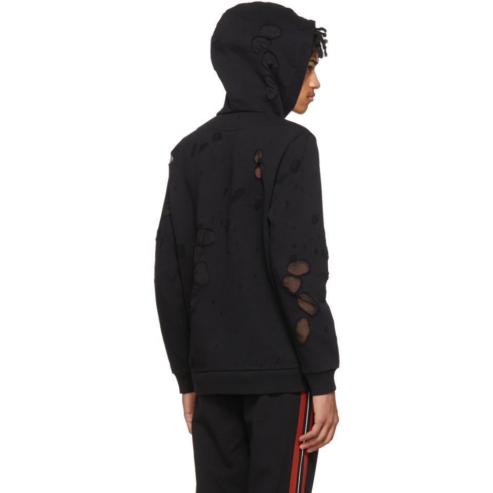 e1ccedb1862 Lyst - Pull a capuche a logo et effet use noir Givenchy pour homme ...