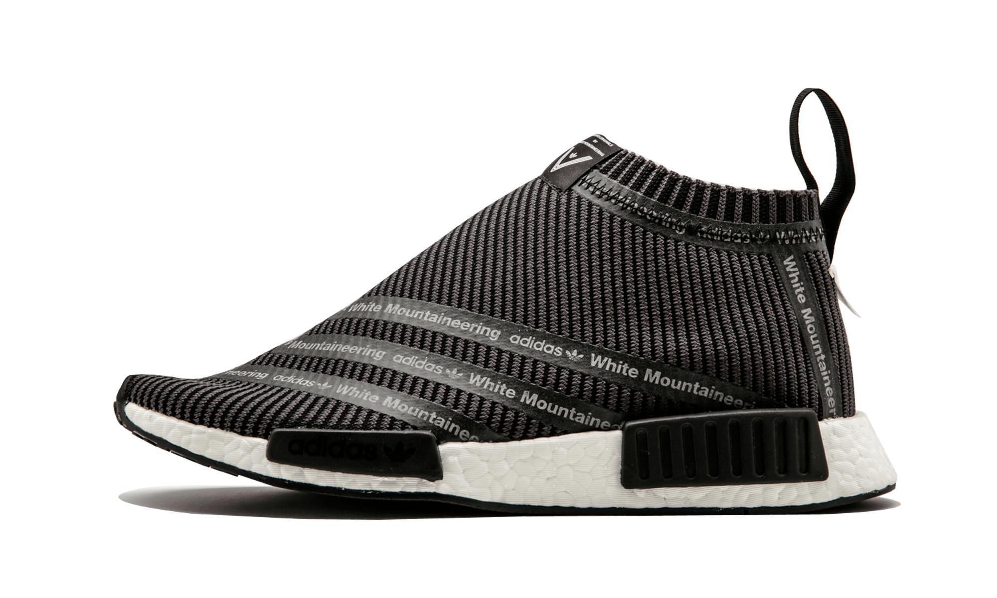 lyst adidas wm nmd città sock in nero per gli uomini.