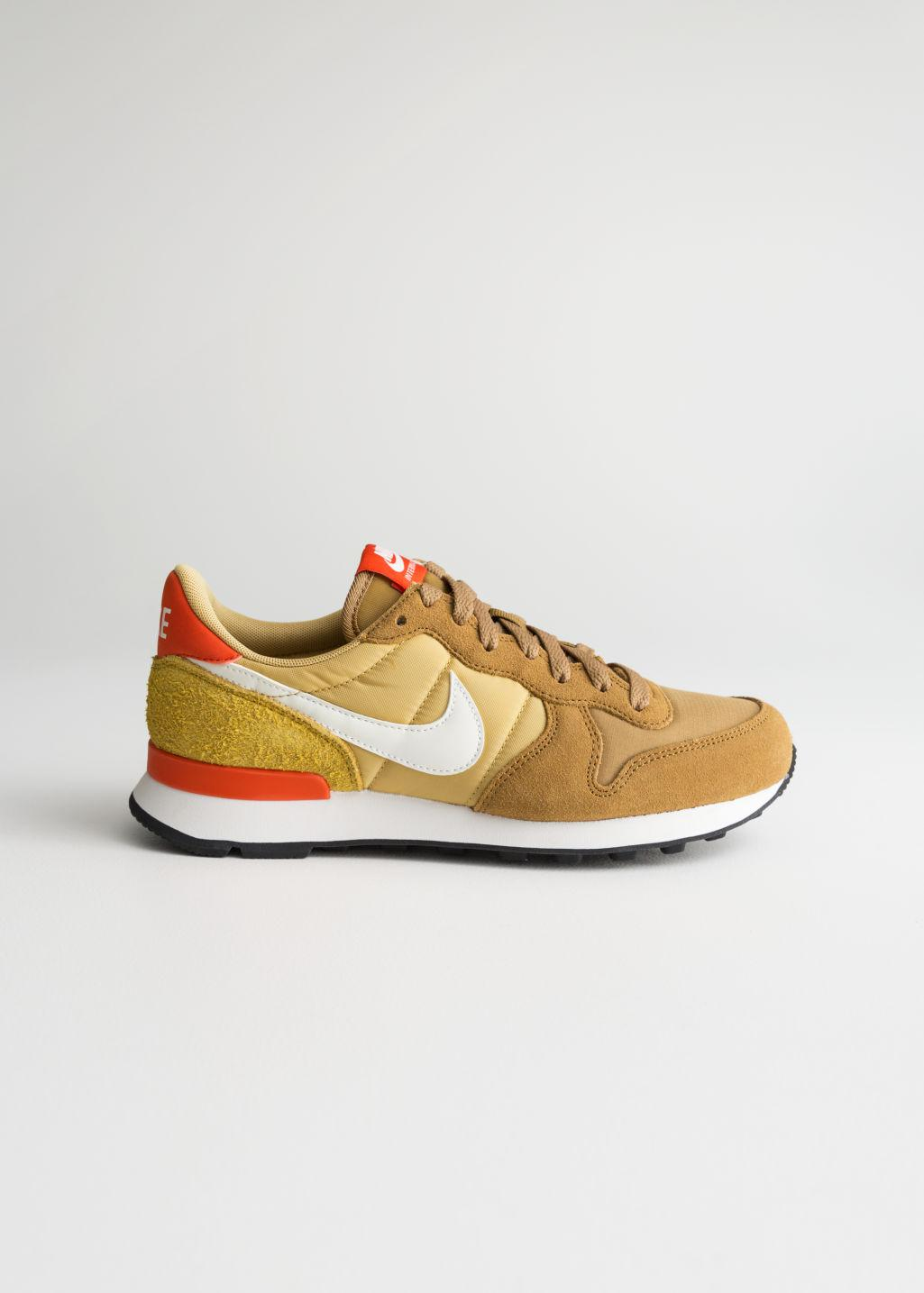 cheaper fa0b7 f6955 Other Stories. Women s Orange Nike Internationalist