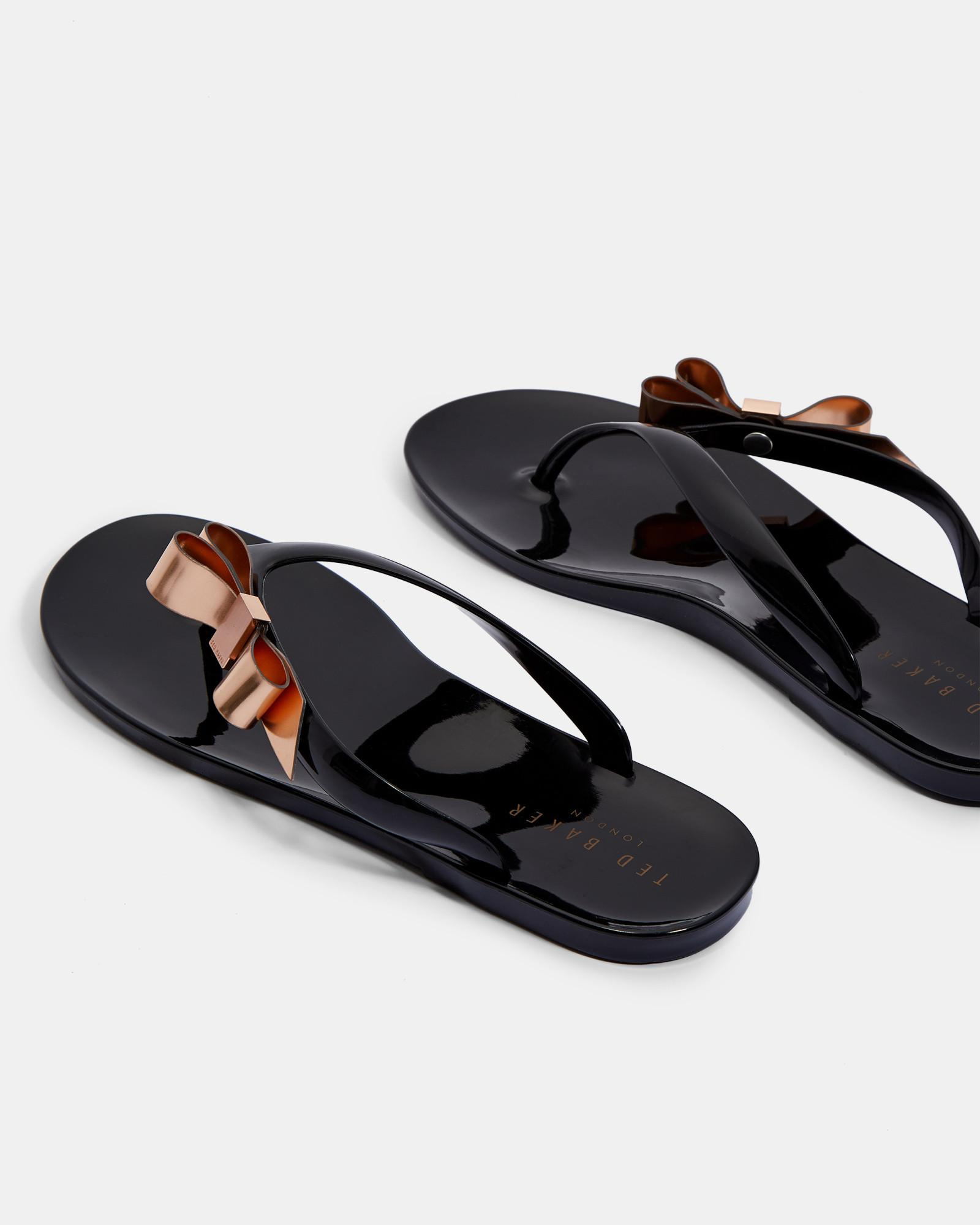 263d8d50e Lyst - Ted Baker Bow Detail Jelly Flip Flops in Black - Save 52%