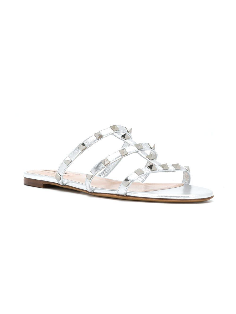 beac6ba5d72f Lyst - Valentino Garavani Rockstud Sandals in Metallic - Save 1%