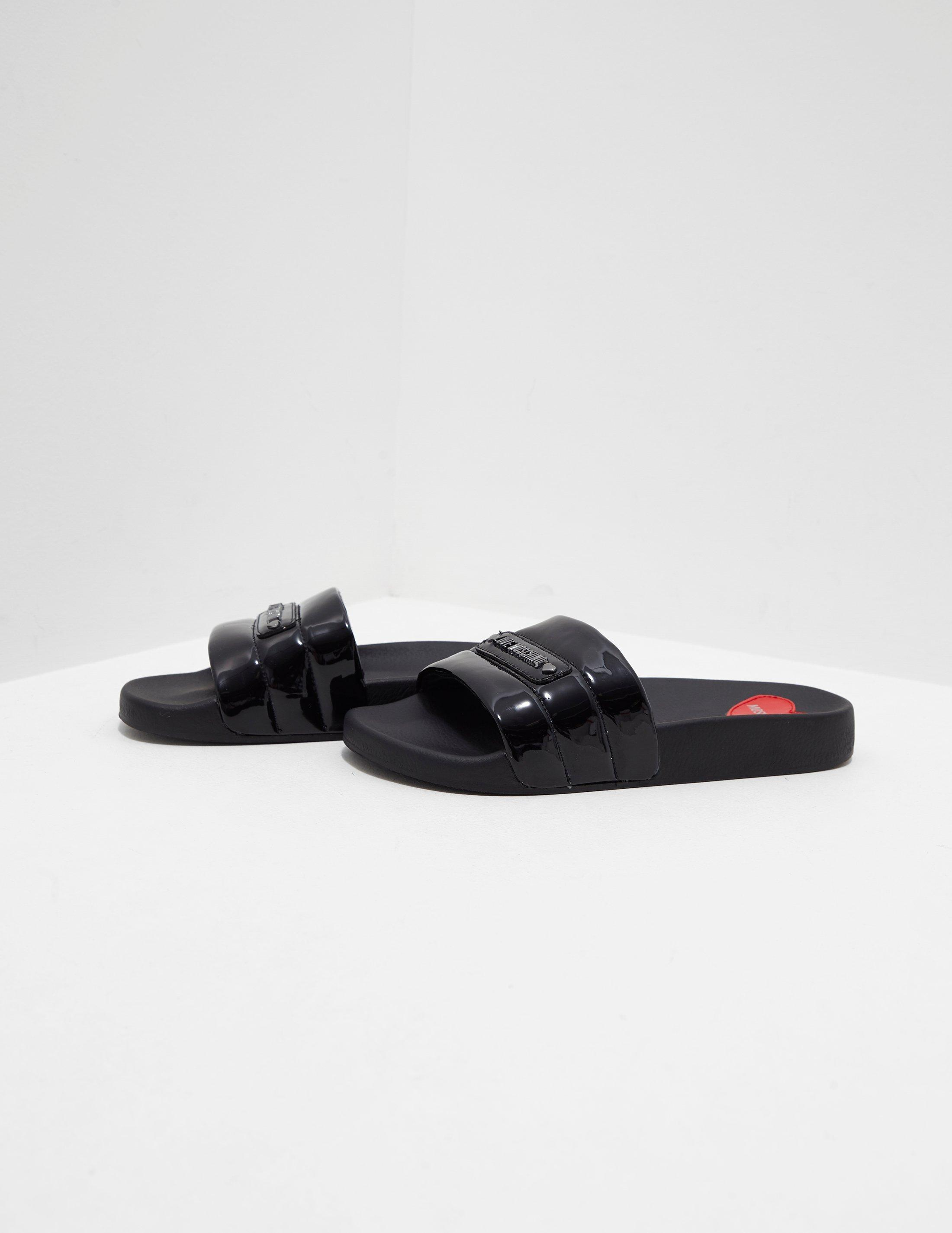 f201dff5043f Love Moschino Quilted Slides Black in Black - Lyst