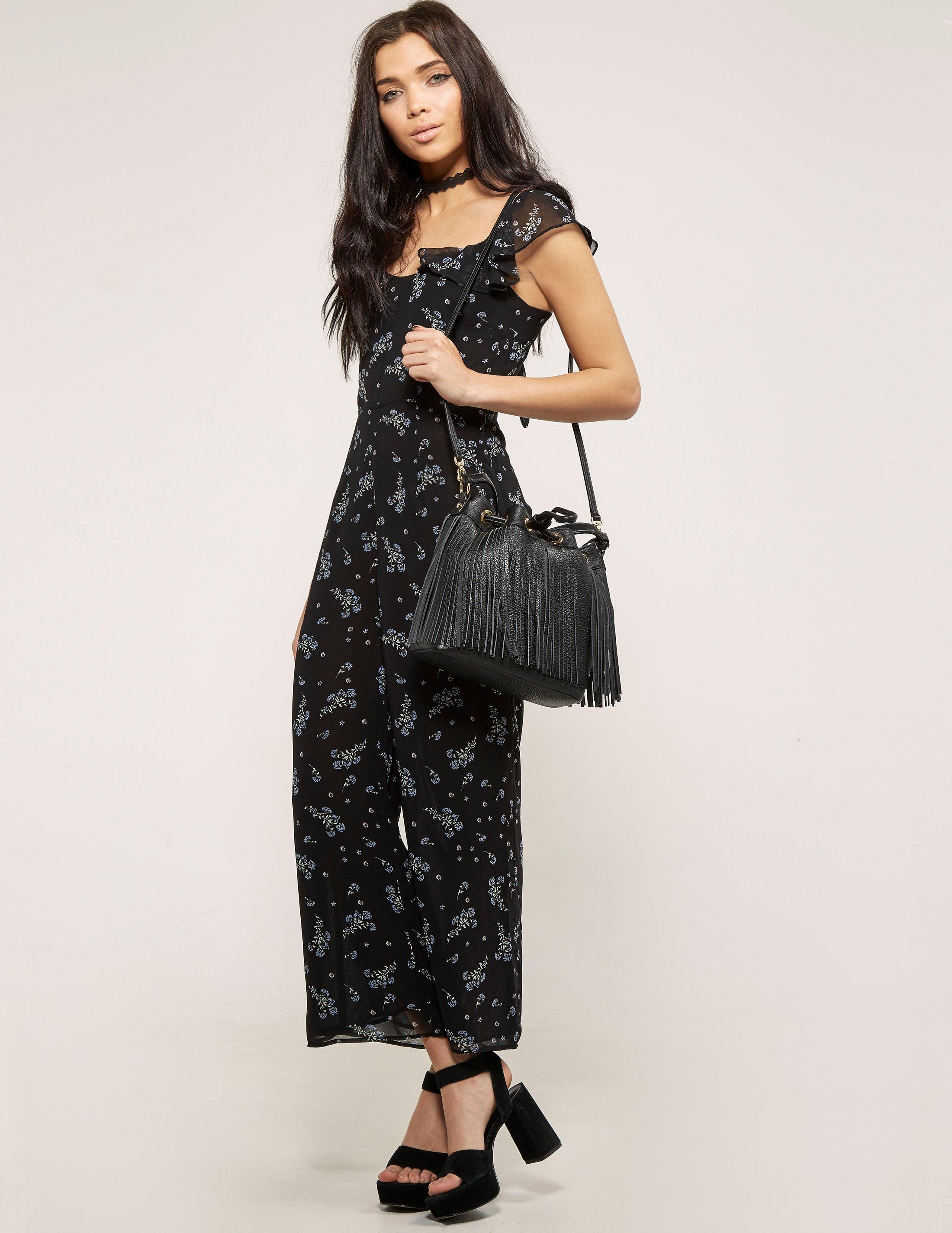 3ead84bb889 Juicy Couture Floral Woven Jumpsuit in Black - Lyst