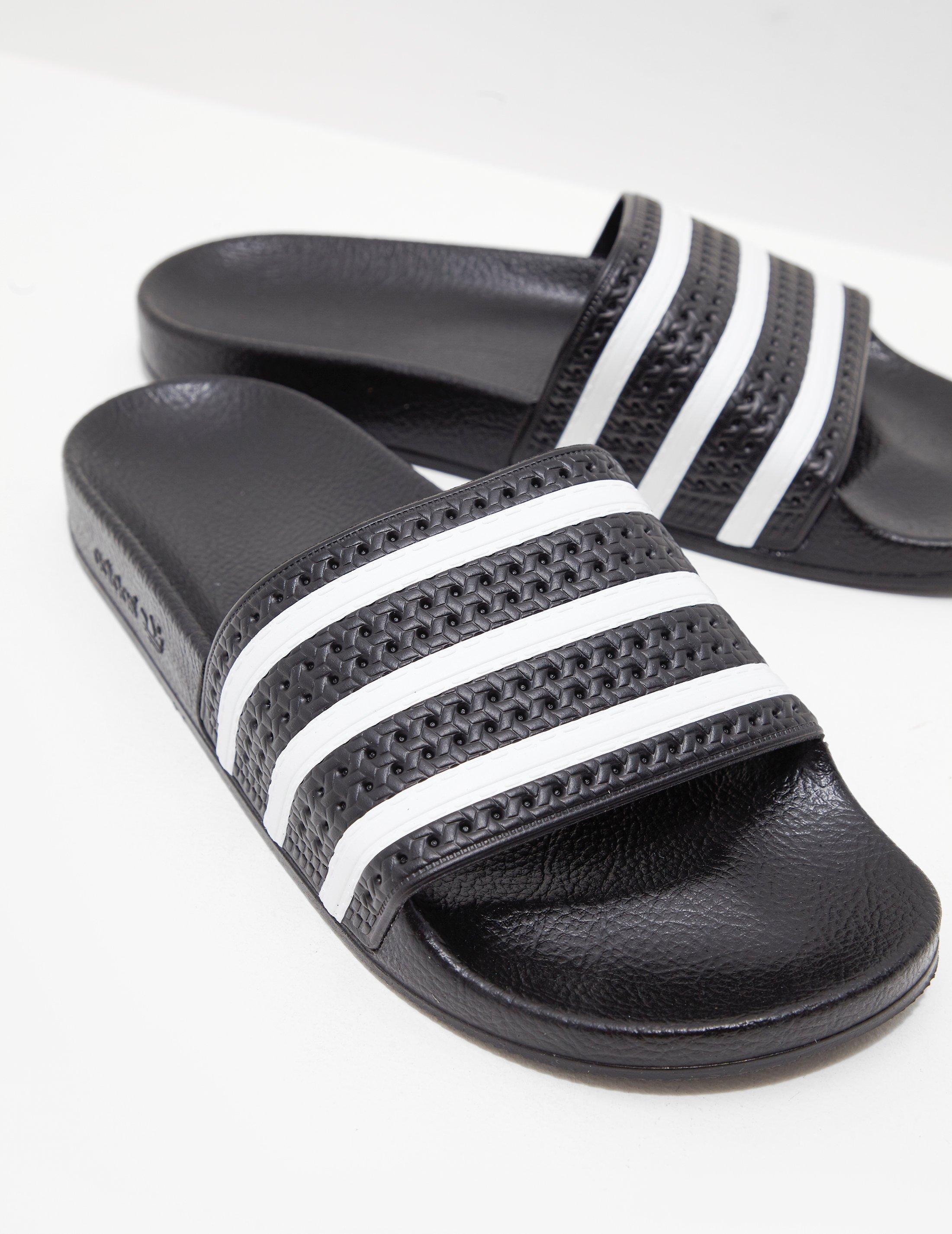 online store cbacb bb875 adidas Originals Adilette Slides Black in Black for Men - Lyst