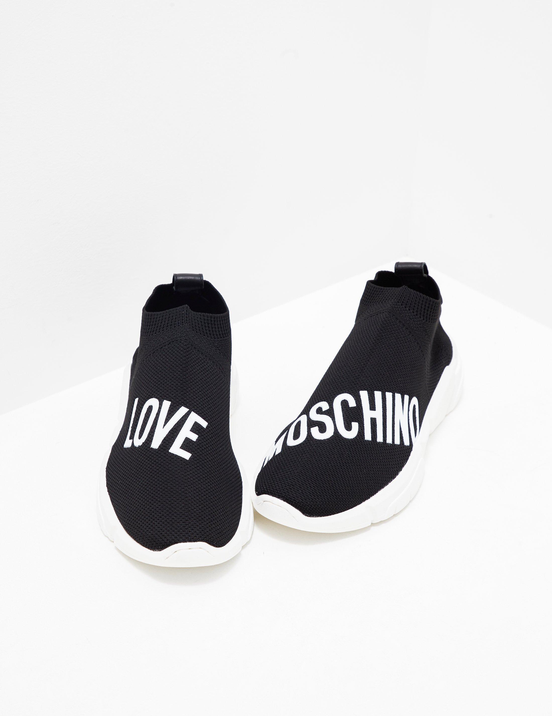 bfeae8df19 Love Moschino Womens Logo Sock Trainer Black in Black - Lyst