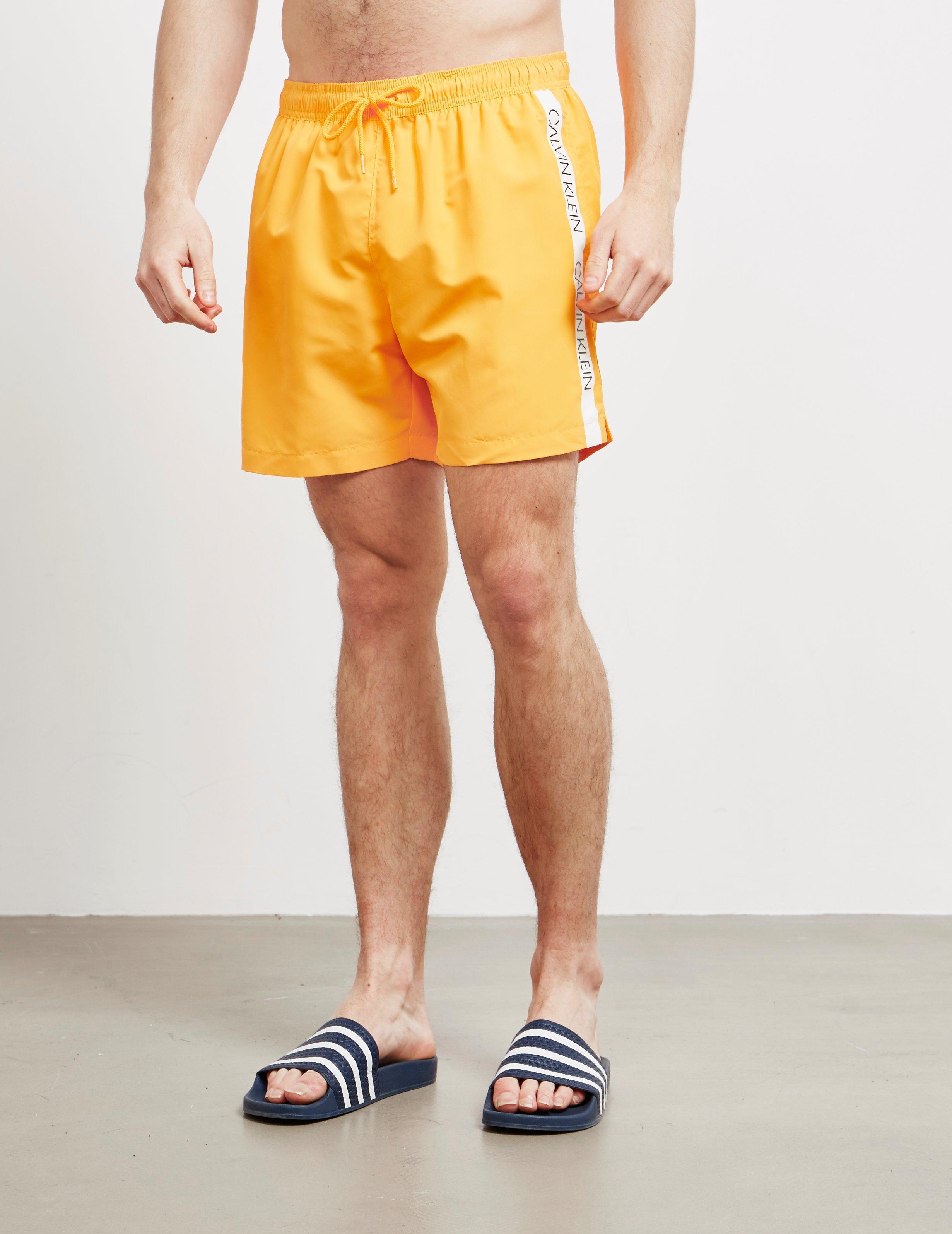 e03cd0f1483 Calvin Klein - Tape Swim Shorts Orange for Men - Lyst. View fullscreen