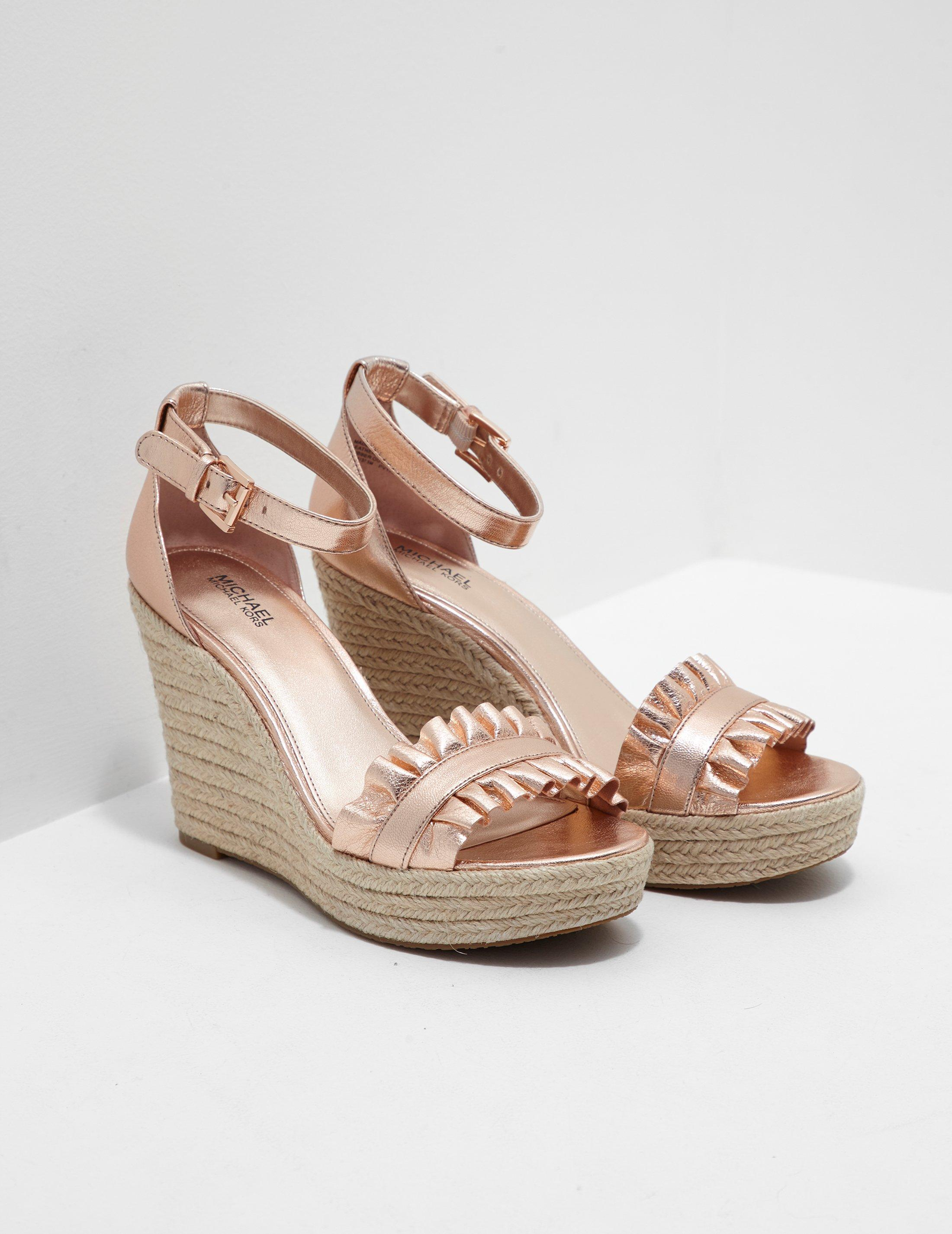 26aade1e9284 Lyst - Michael Kors Bella Wedges Gold in Metallic - Save 17%