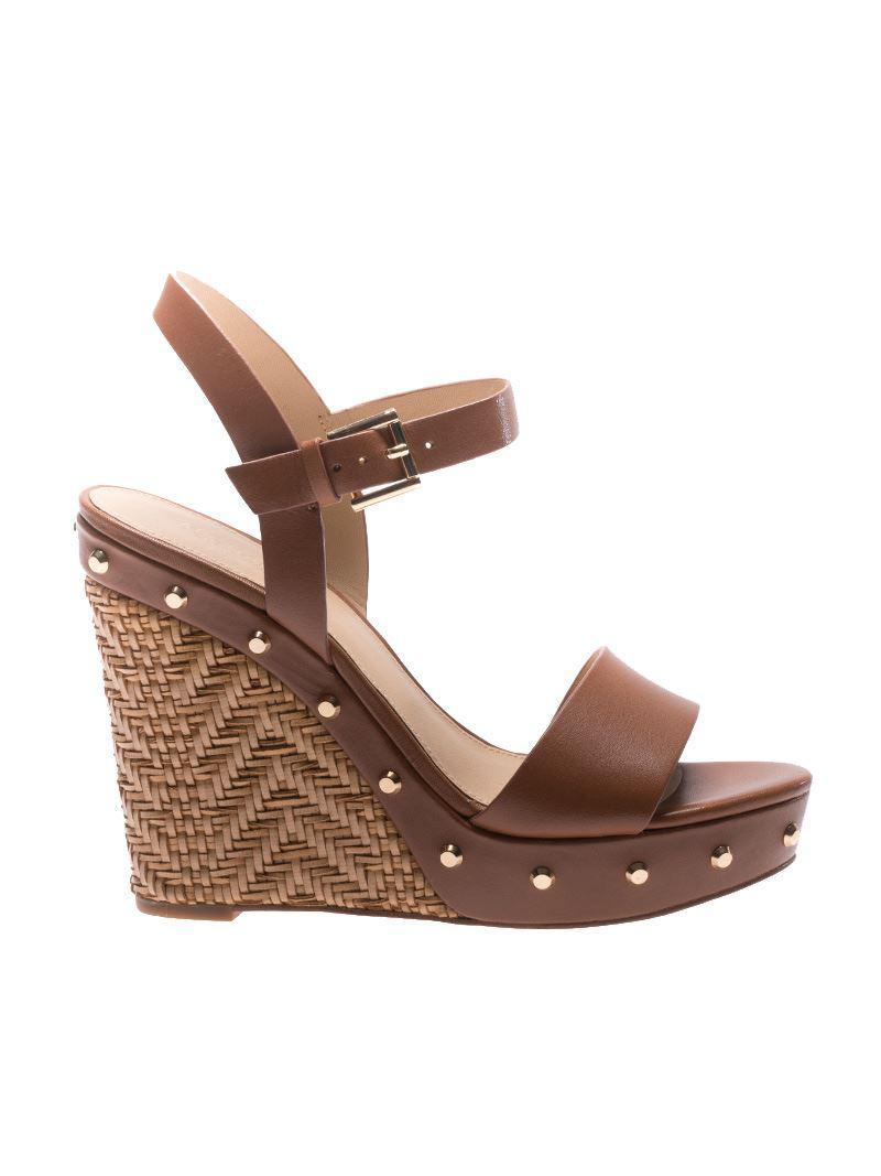ae84692c9a20 Lyst - Michael Kors Brown Ellen Wedge Sandals in Brown