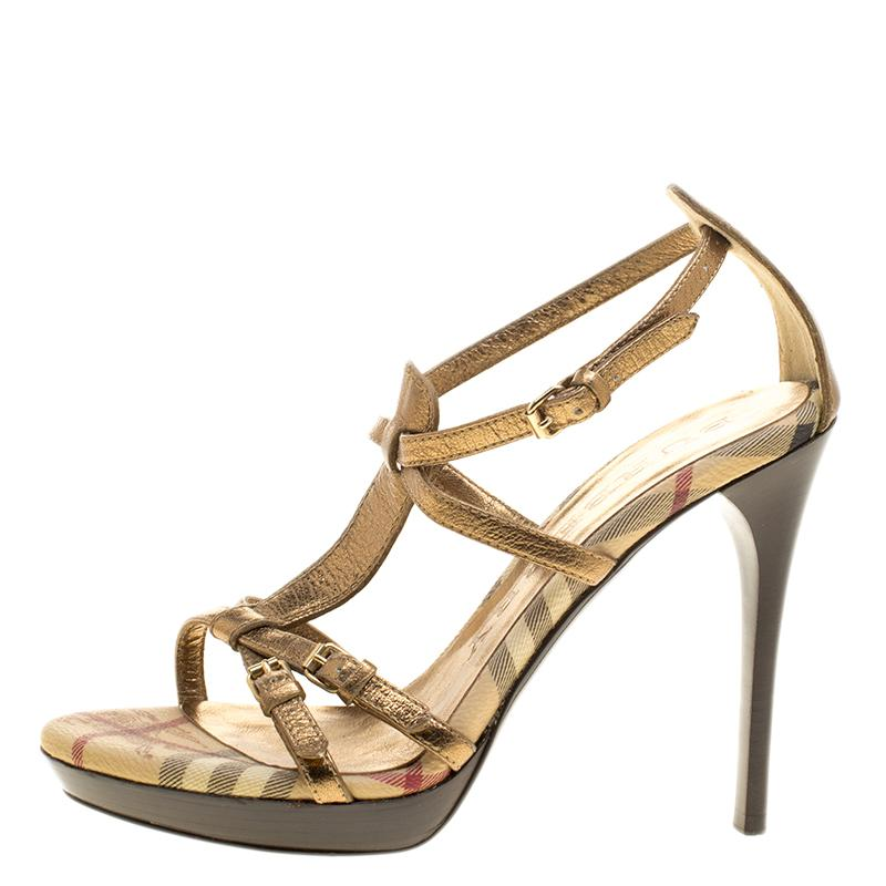 8cee5ffcfb1 Lyst - Burberry Dull Gold Leather Strappy Platform Peep Toe Sandals ...
