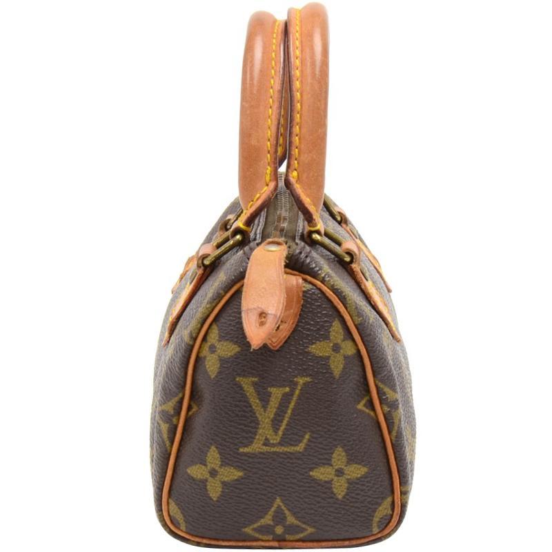 18ff50fc8e2f Louis Vuitton - Brown Monogram Canvas Mini Hl Bag - Lyst. View fullscreen