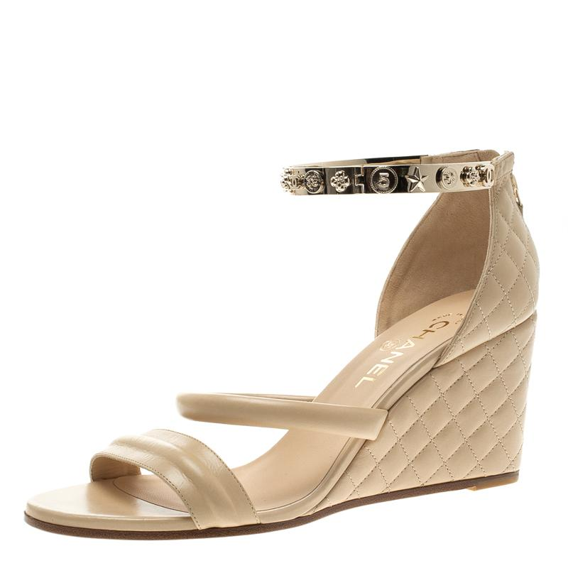 611686490326 Chanel. Women s Natural Beige Quilted Leather Charm Embellished Ankle Cuff  Wedge Sandals Size 40.5
