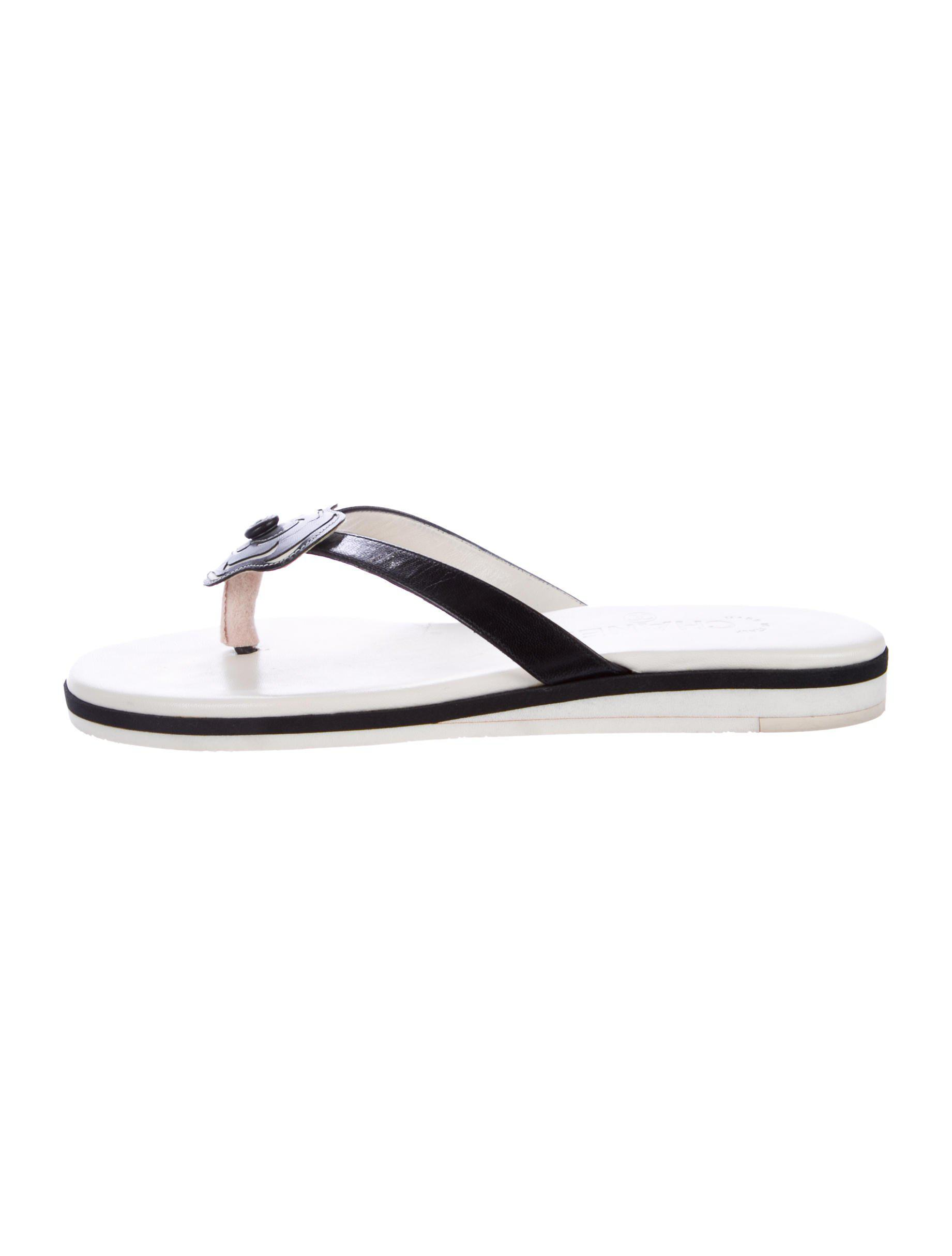 22e68c07eea722 Lyst - Chanel Camellia Cc Thong Sandals in Black