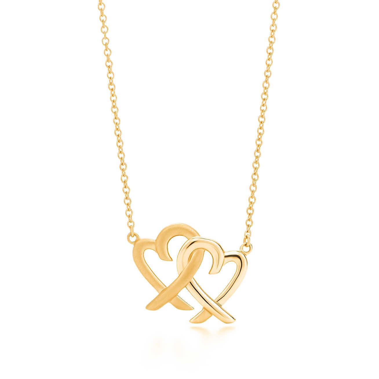 Tiffany co loving heart interlocking pendant in metallic lyst gallery aloadofball Gallery