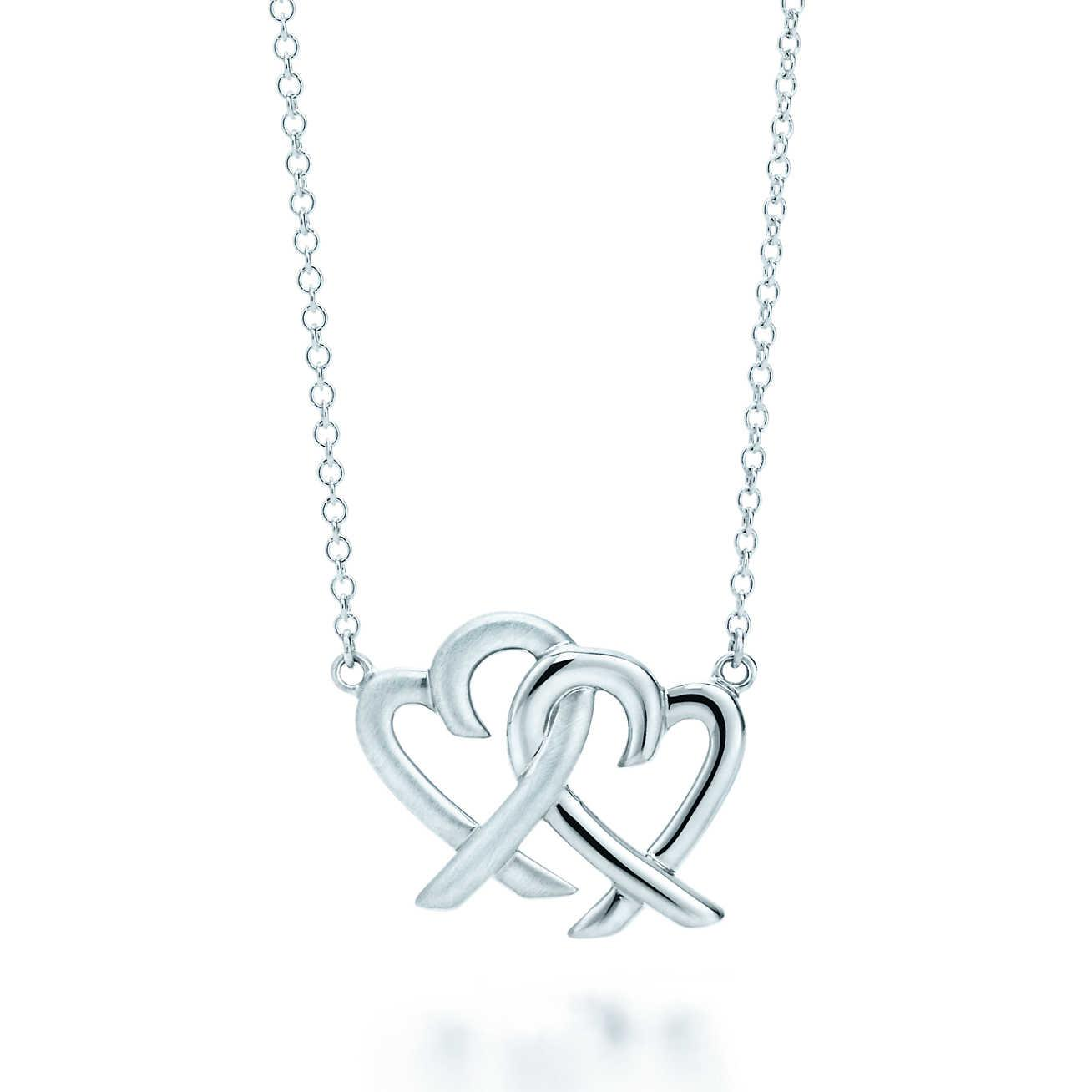 748a6758c Tap to visit site. Tiffany & Co - Metallic Loving Heart Interlocking Pendant  ...
