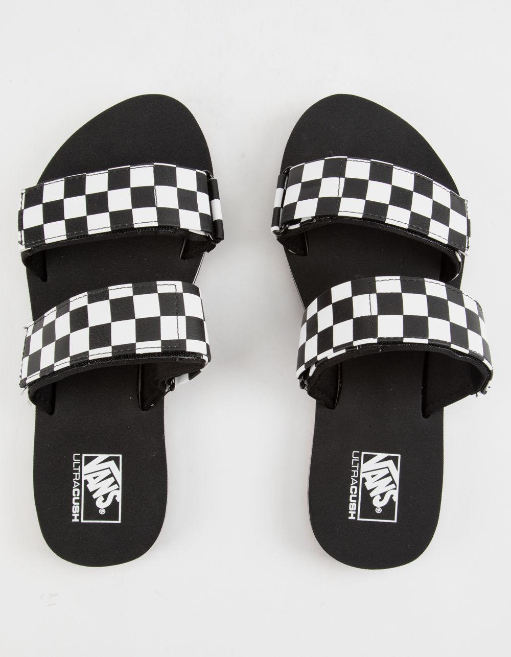 321ae99f2ea Lyst - Vans Cayucas Checkerboard Womens Slides in Black