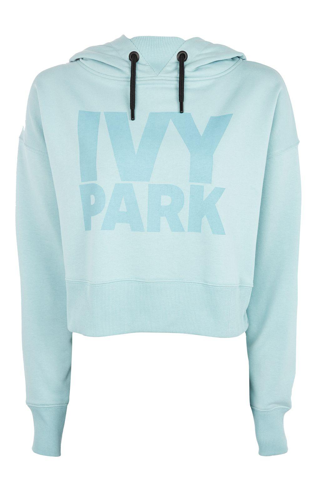 lyst ivy park cropped logo hoodie by in blue. Black Bedroom Furniture Sets. Home Design Ideas